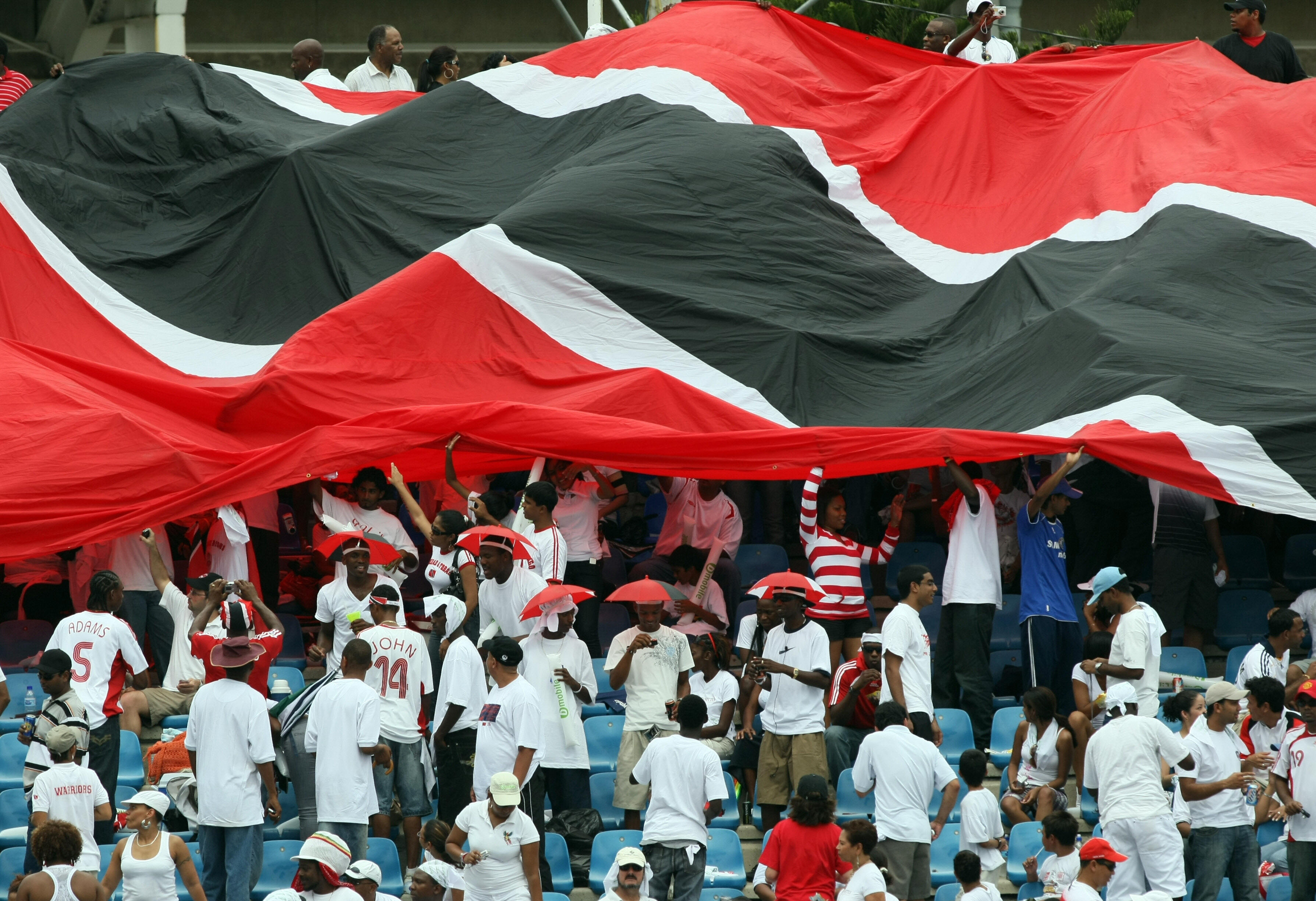 Football fans display a giant Trinidad a