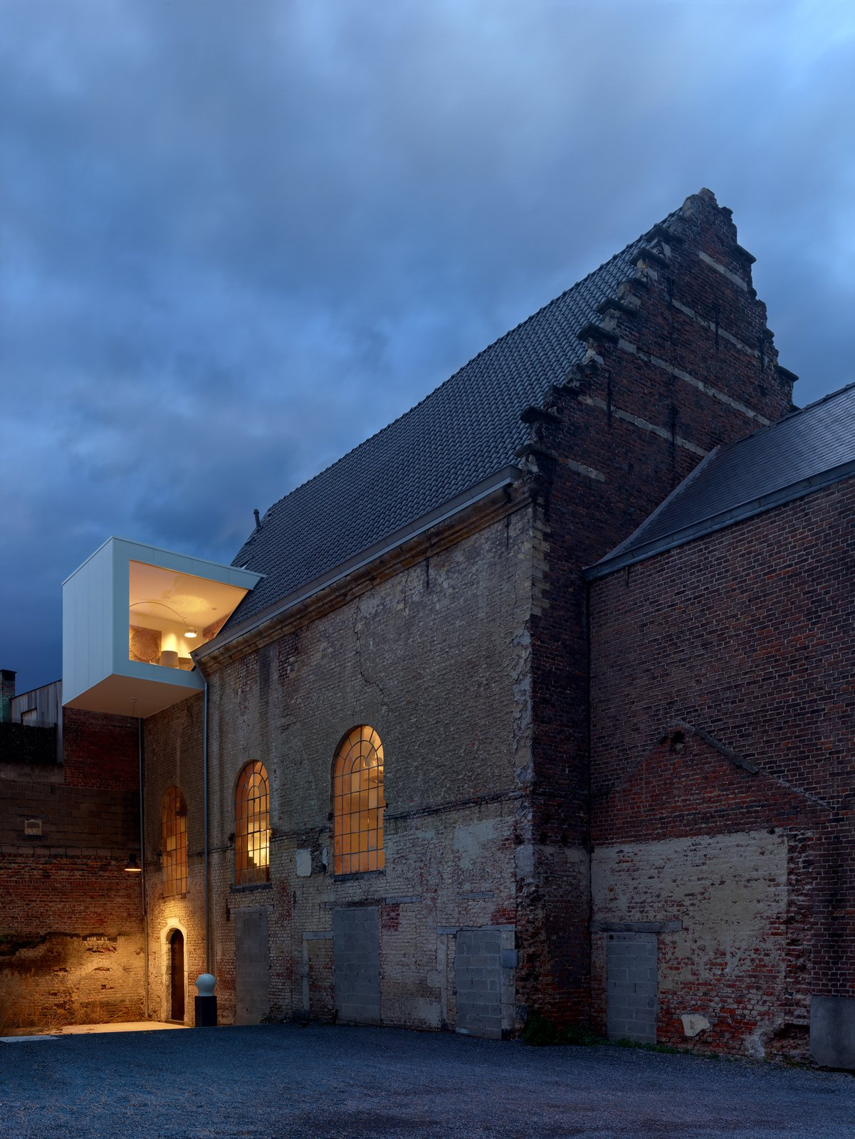 modern office inserted into historic brick chapel