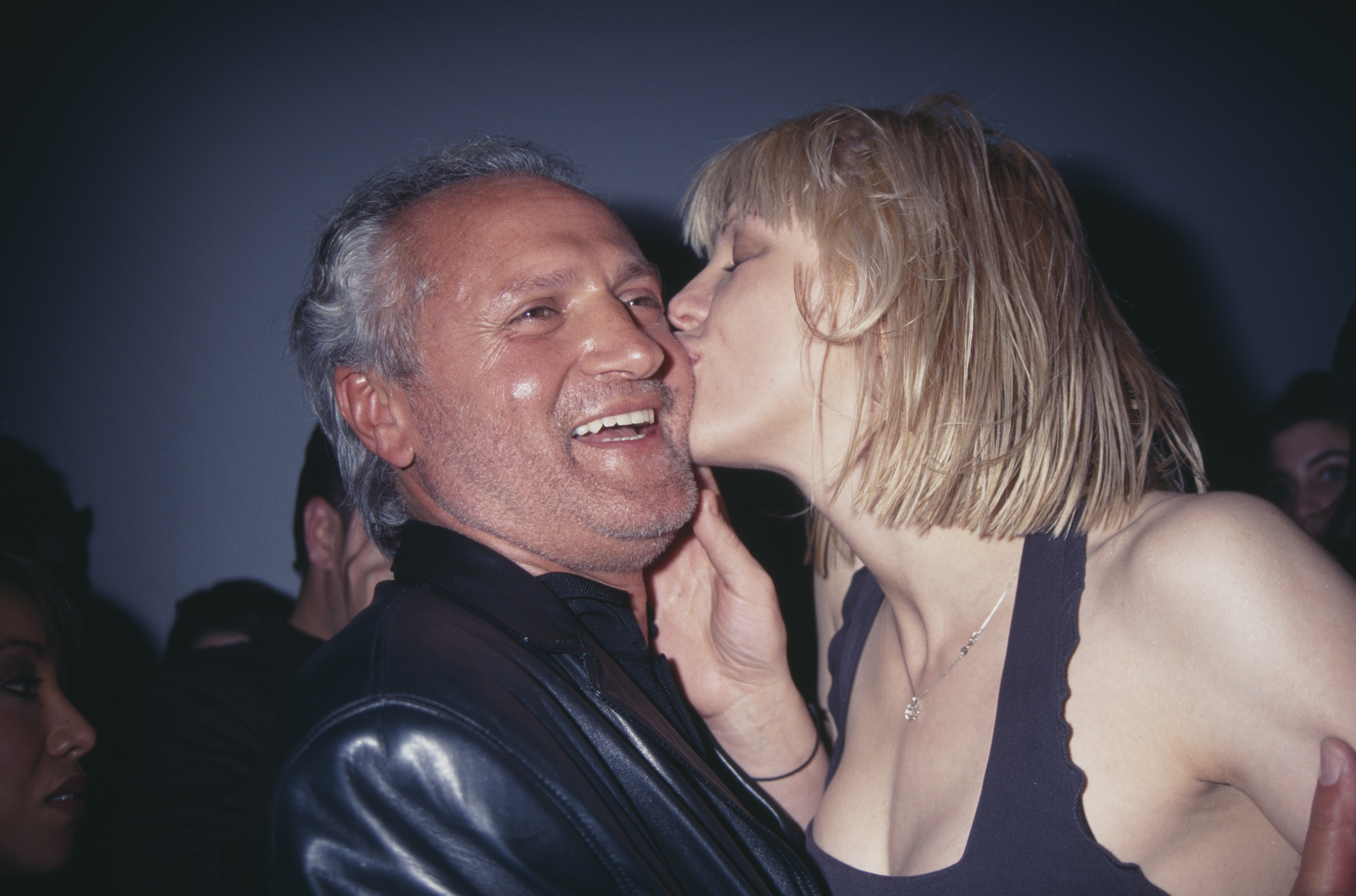Courtney Love and Gianni Versace before one of the late designer's fashion shows in 1997.