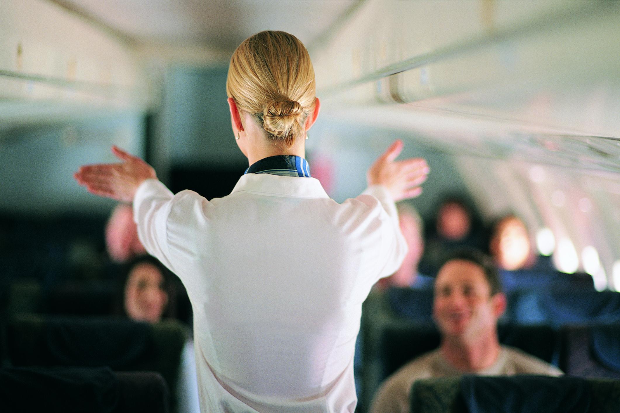 Flight attendant on board a plane
