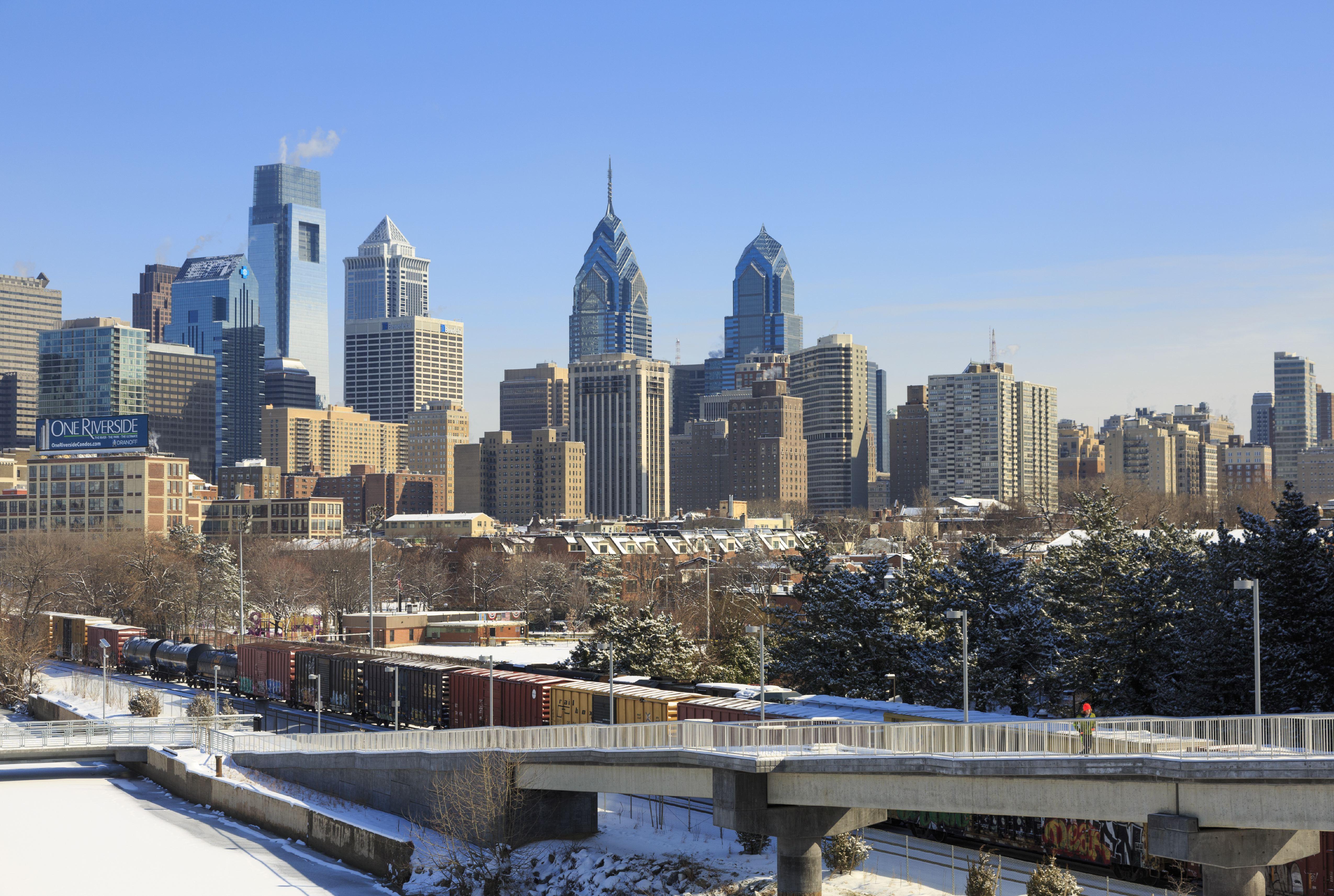 Train with Philadelphia Skyline in winter, USA