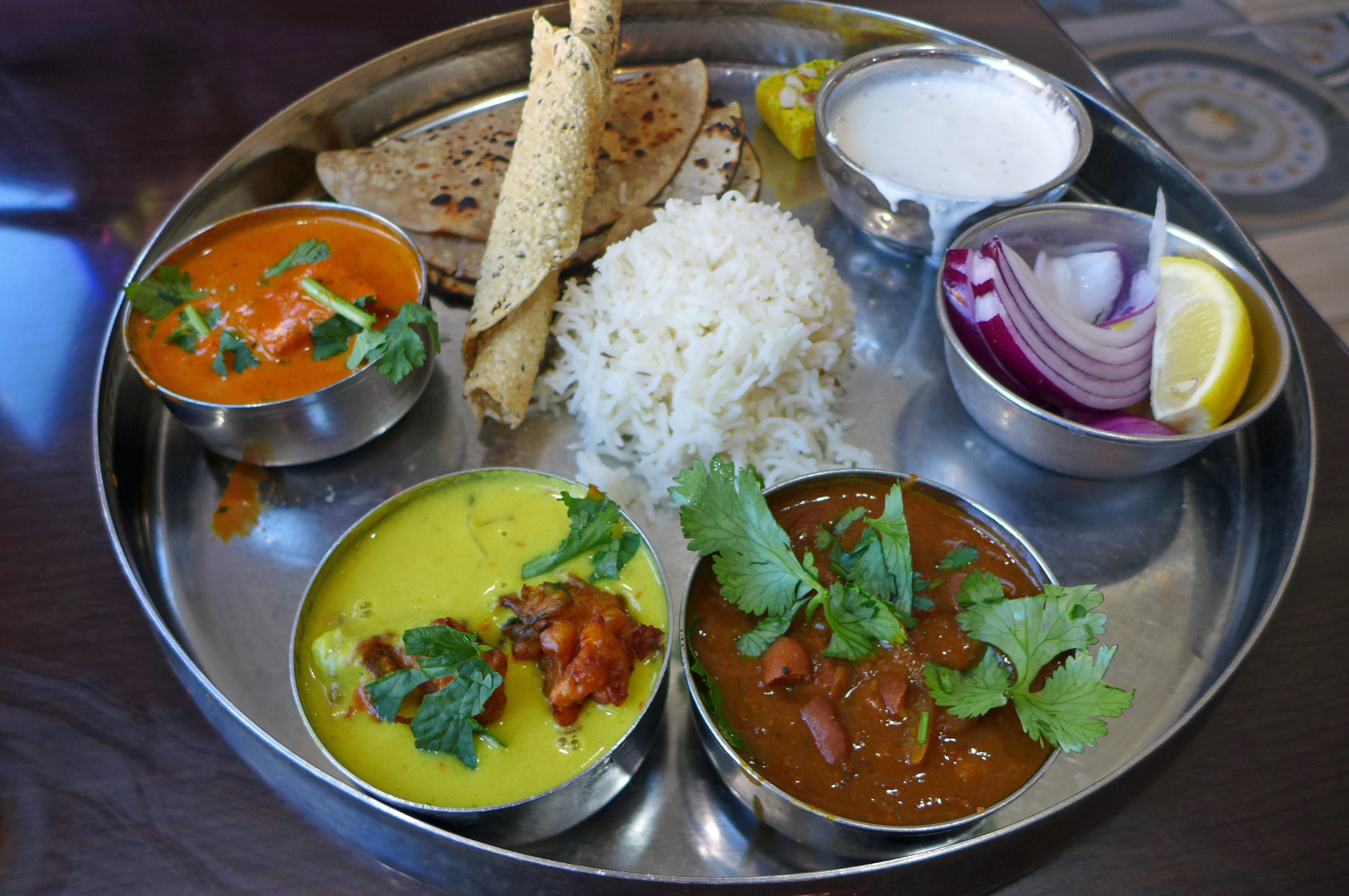 The special thali at Mithaas comes on a metal tray