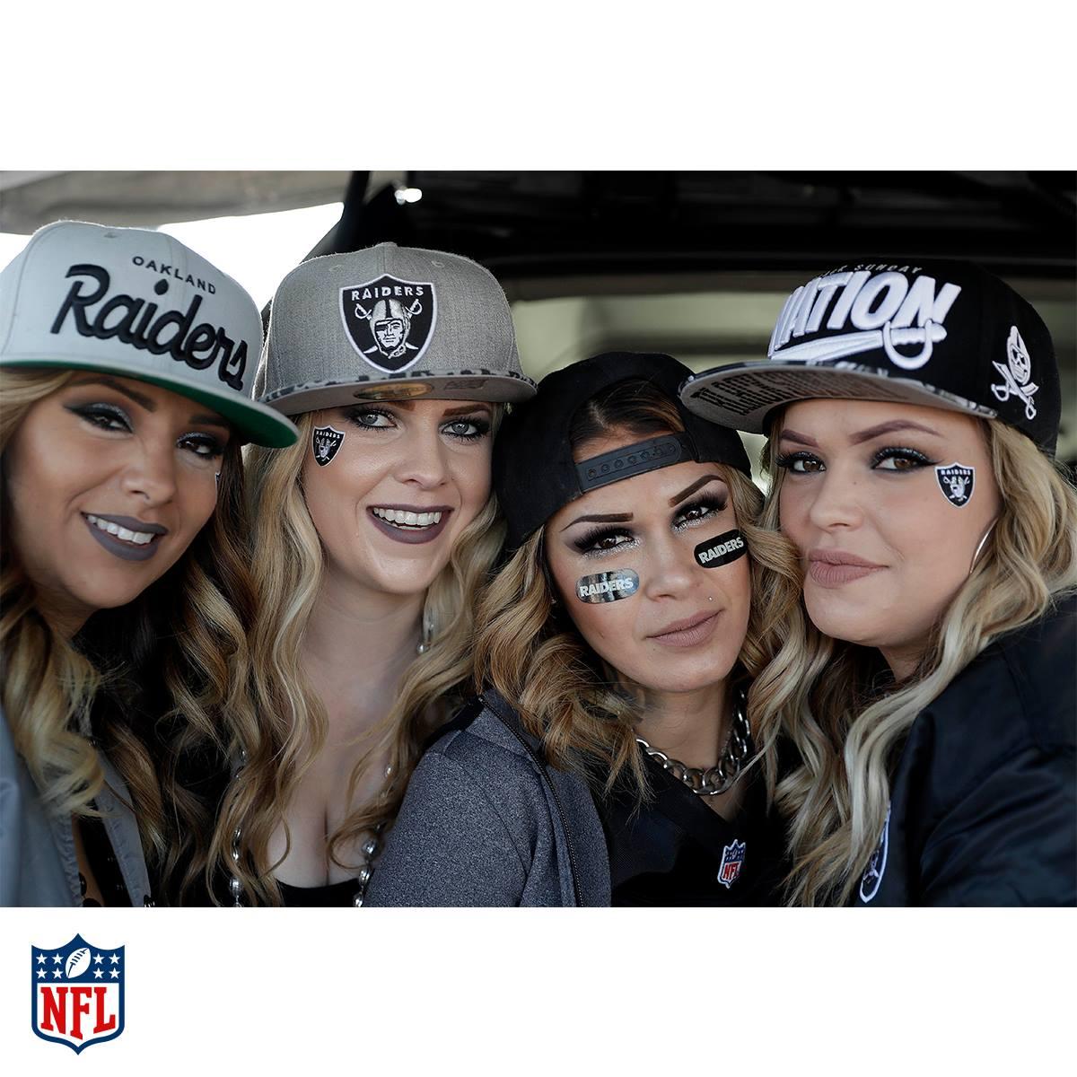 Four women in Oakland Raiders hats