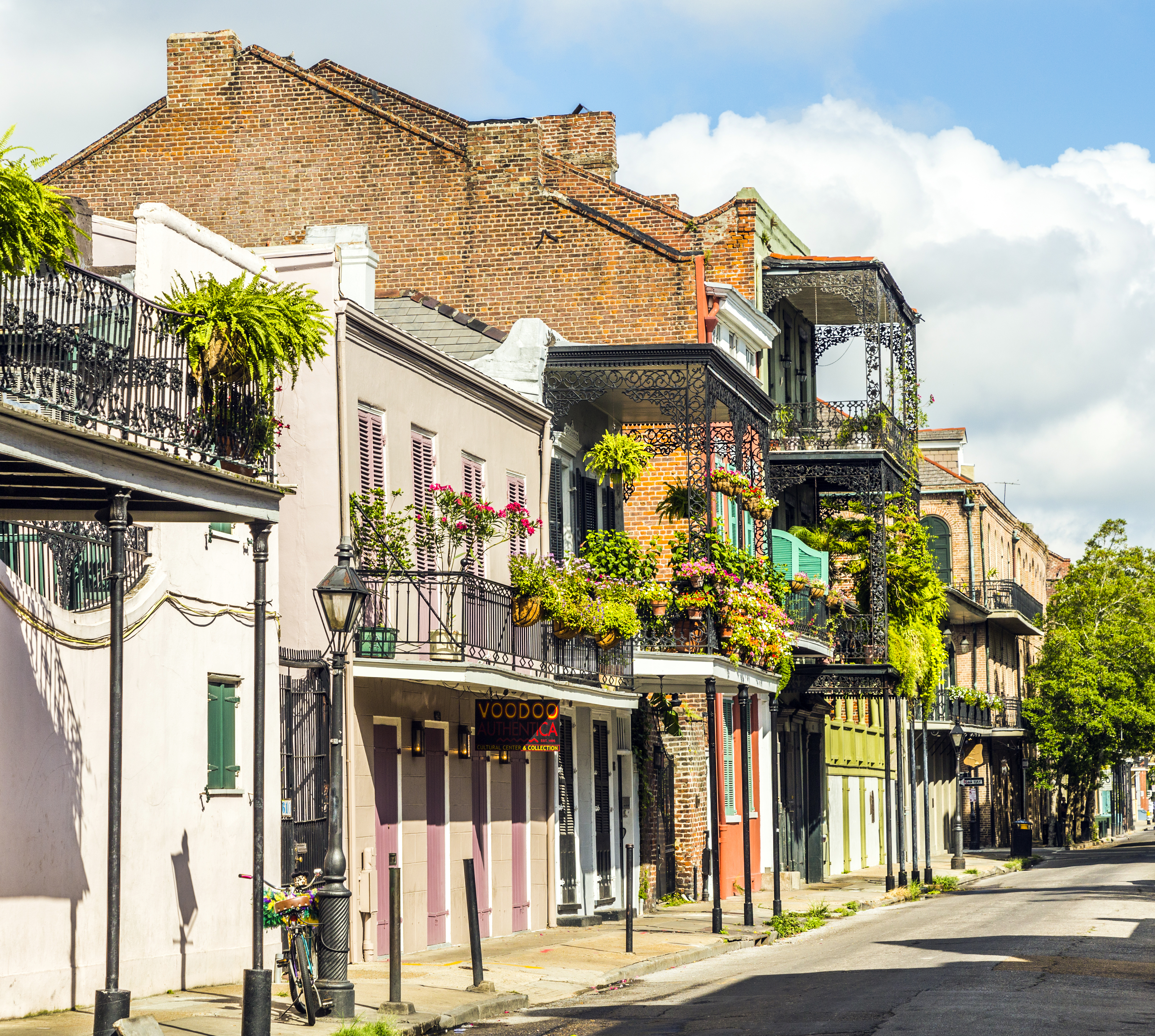 a street of historic buildings in the new orleans french quarter