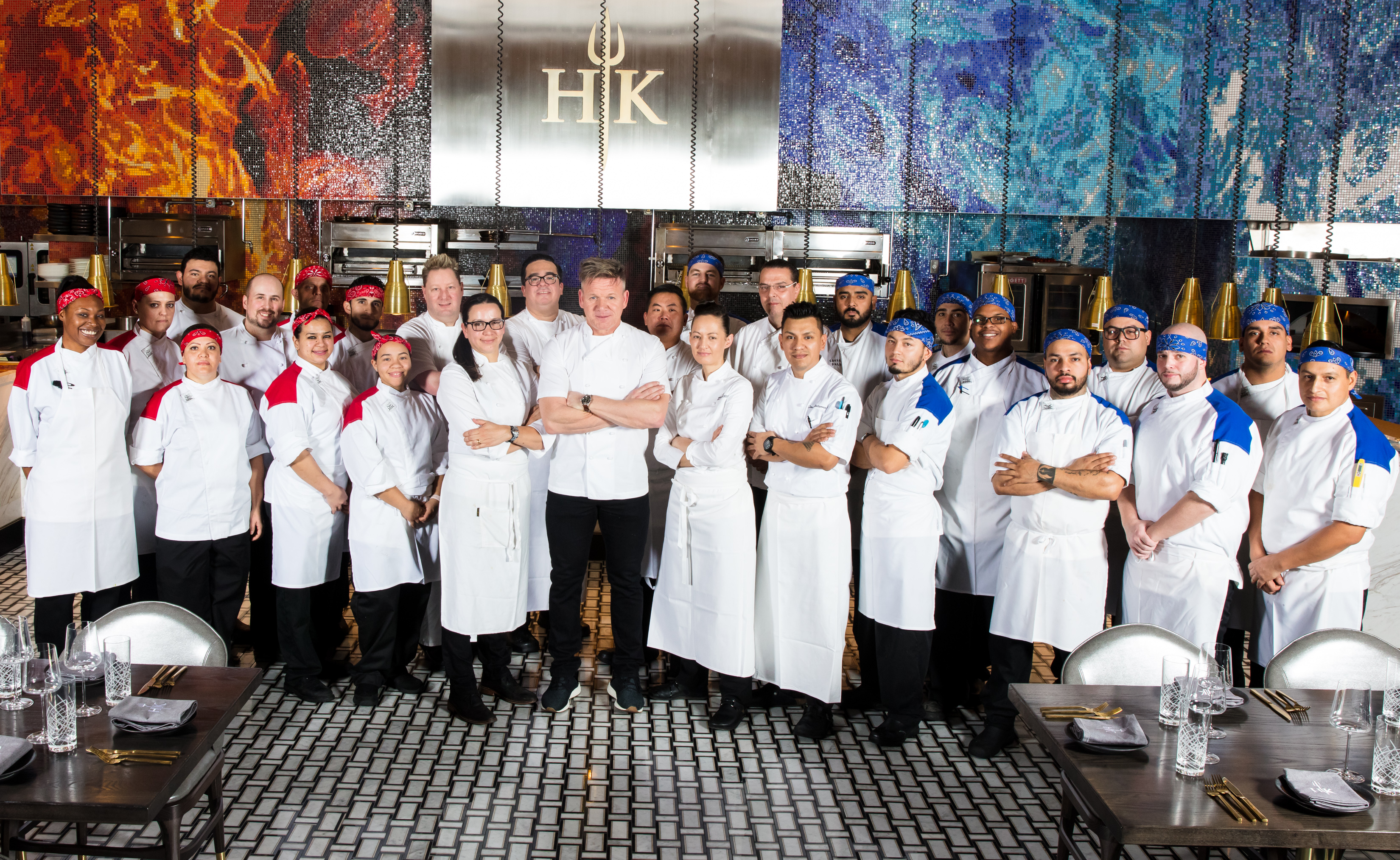 Gordon Ramsay with the chefs at Gordon Ramsay Hell's Kitchen