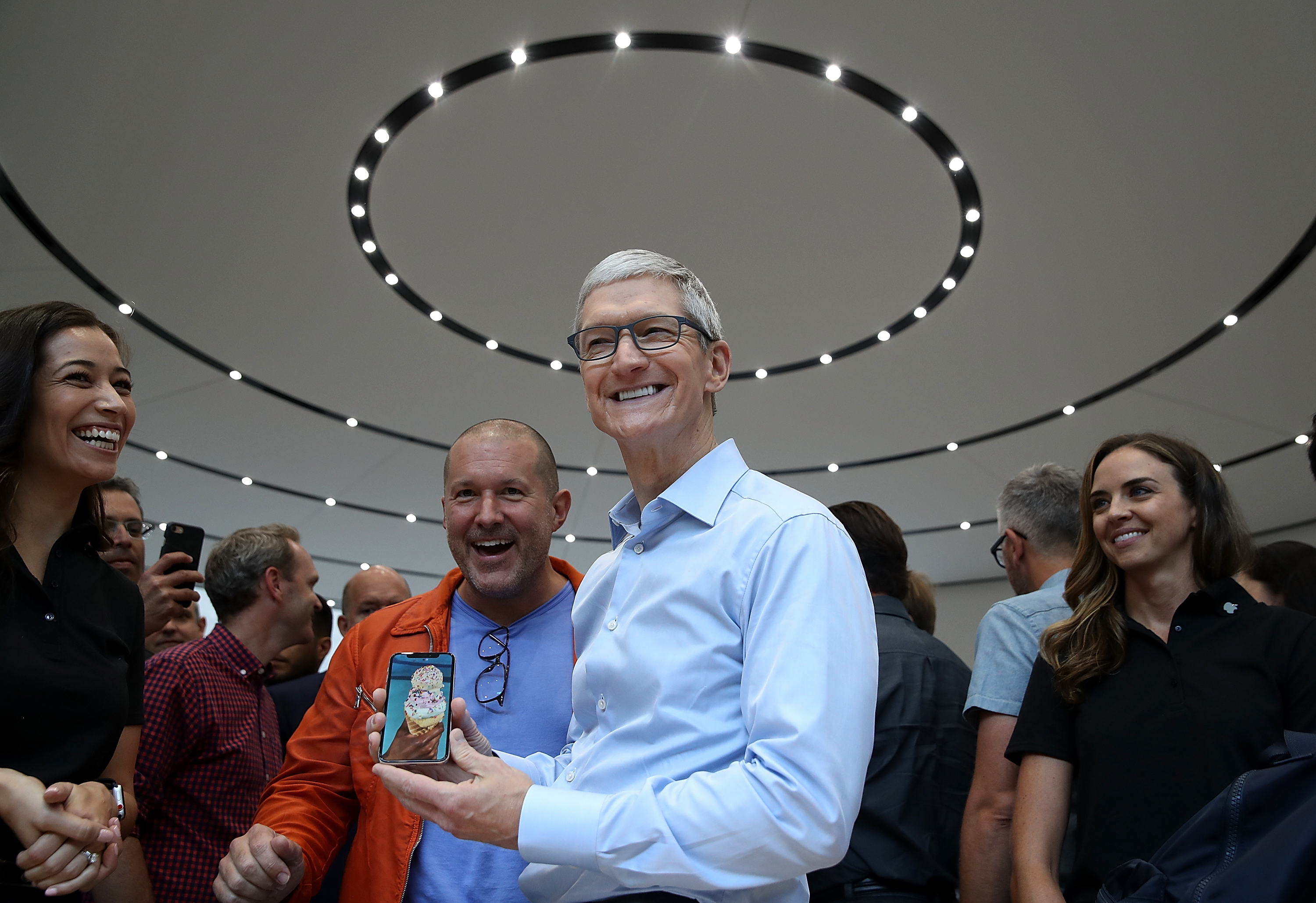 Apple designer Jony Ive and CEO Tim Cook hold the new iPhone X at the launch event.
