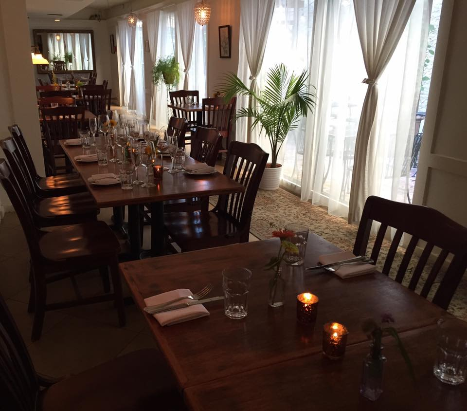 romantic restaurant with candles on the tables