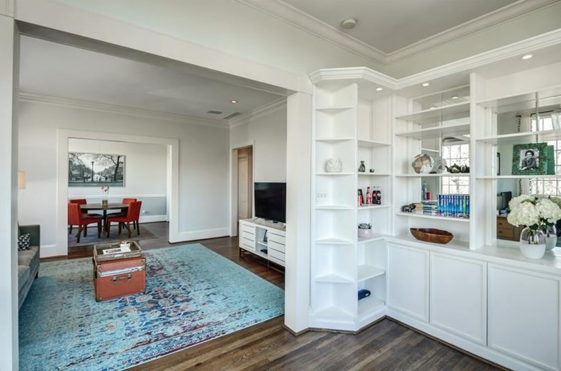 Interior of condo with built-in shelves and furniture.