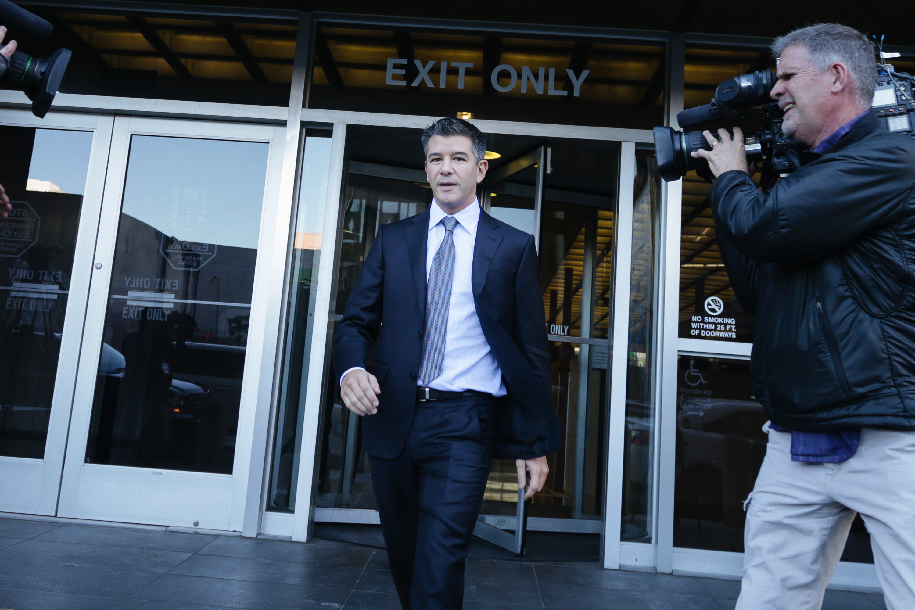 Former Uber CEO Travis Kalanick walks out of the Federal Building where the Uber-Waymo trial is taking place.