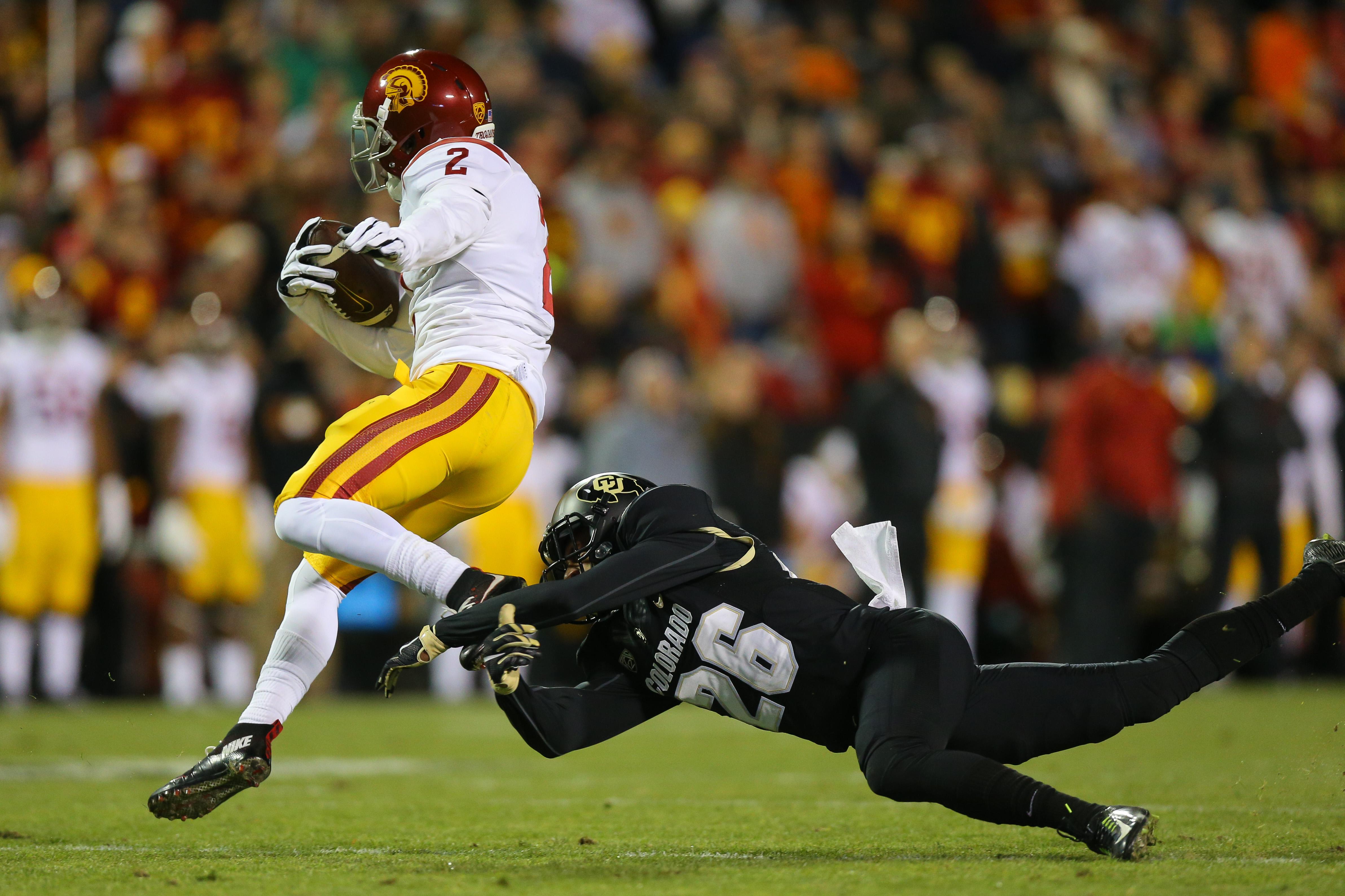 Colorado CB Isaiah Oliver tackles USC CB/KR/PR Adoree Jackson
