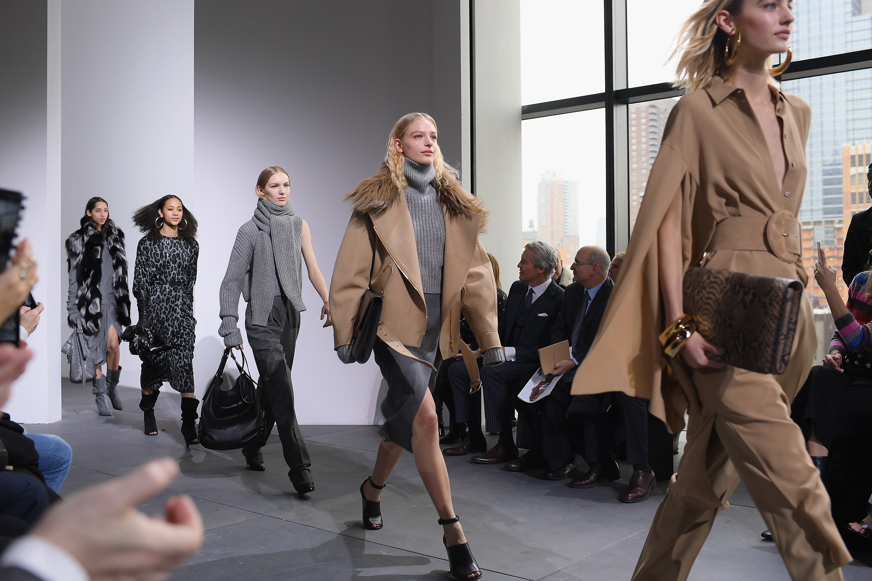 Models walk the runway during a Michael Kors Collection show.