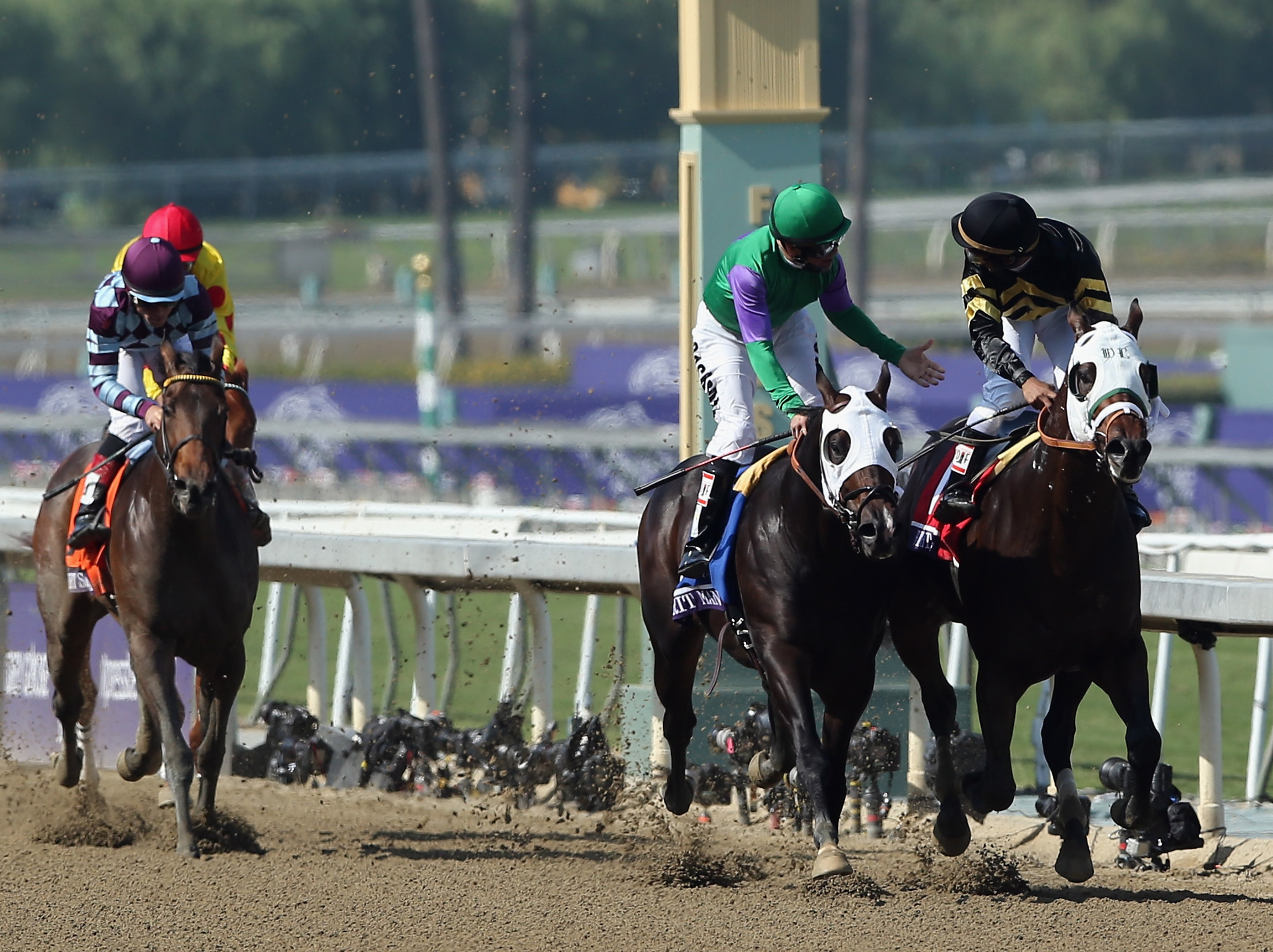 Merit Man finishing second to Hightail in the Breeders' Cup Juvenile Sprint.