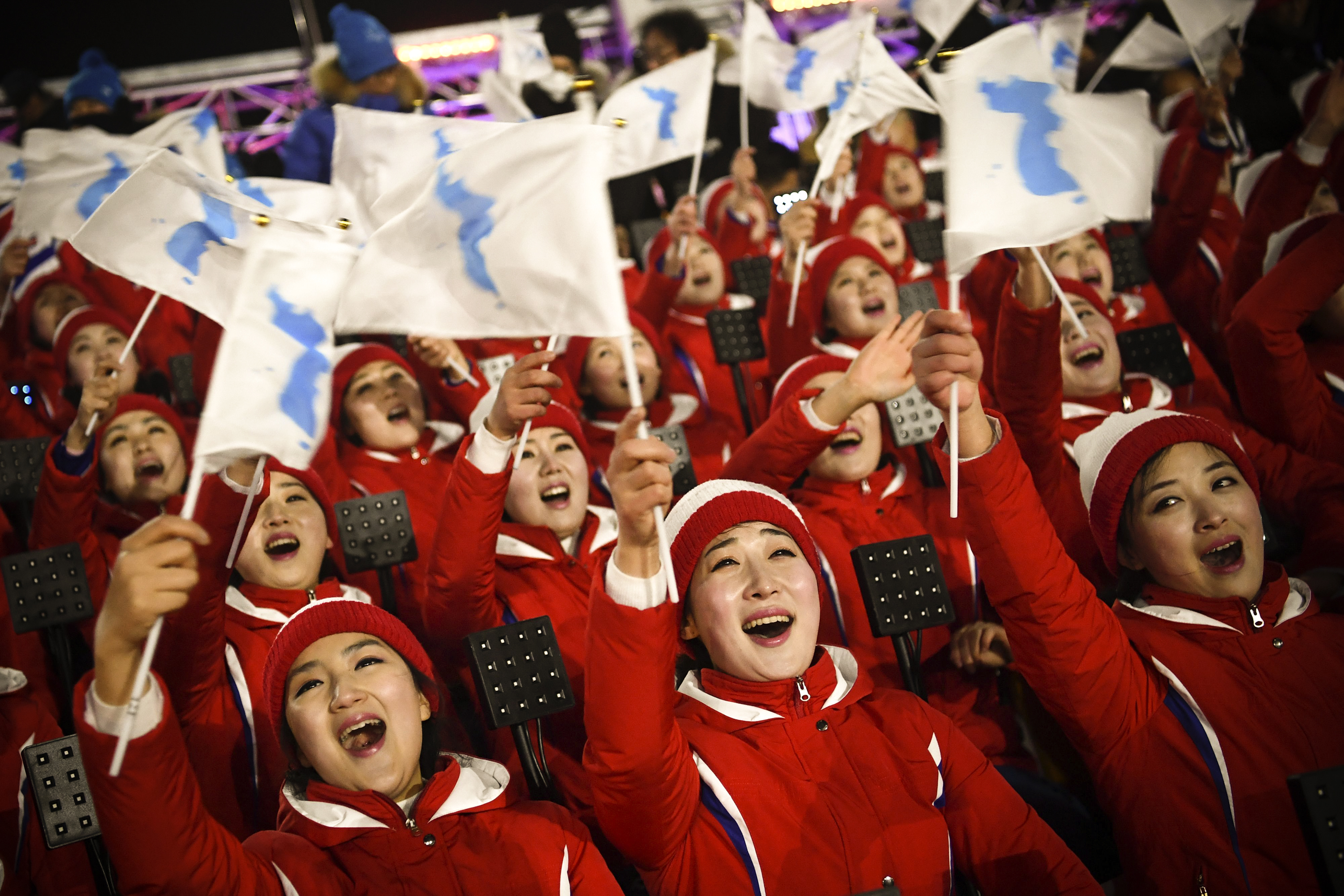 Members of the North Korean cheering band wave flags ahead of the opening ceremony of the Pyeongchang 2018 Winter Olympic Games on February 9, 2018.