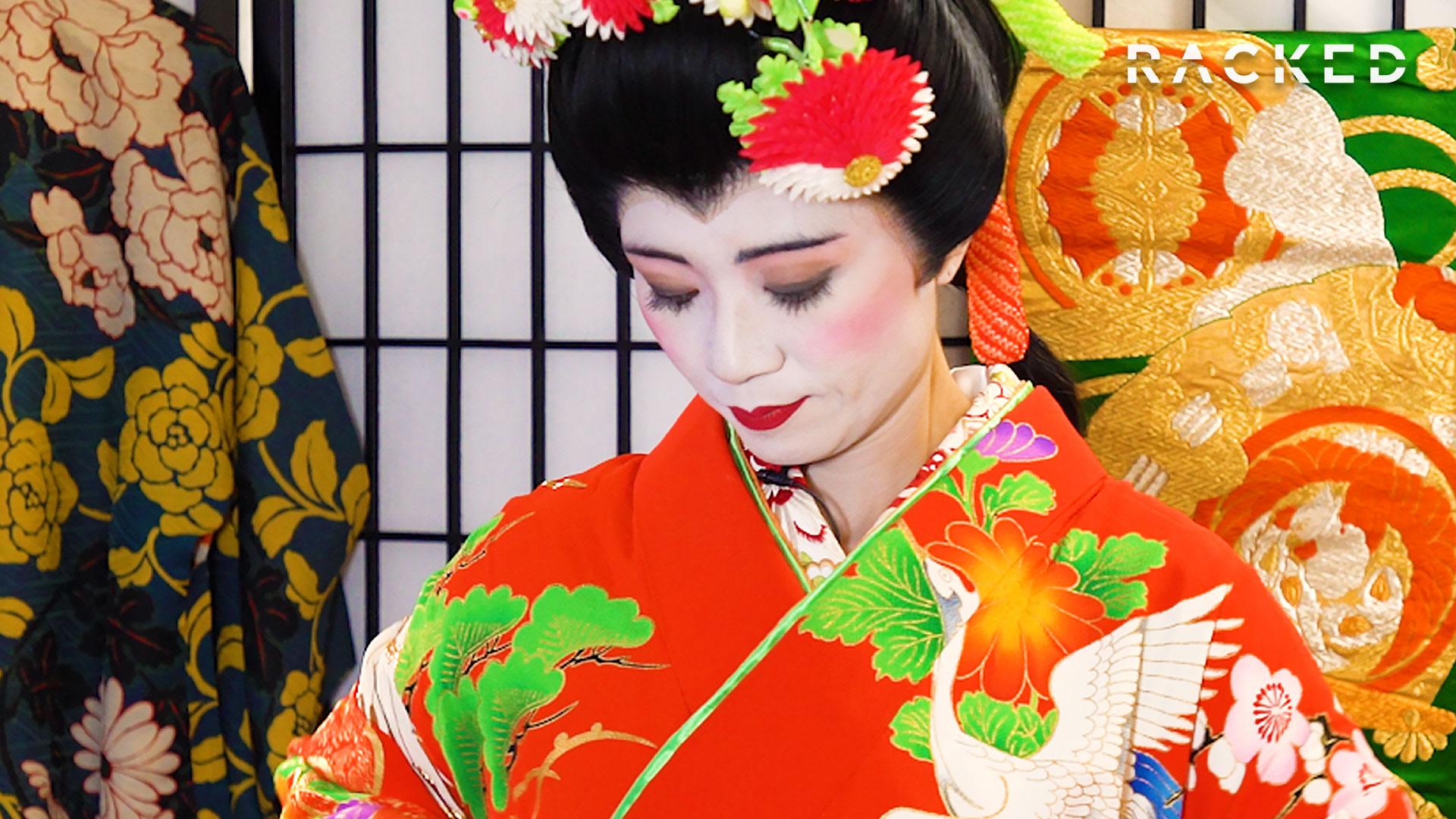 Woman peering down at her kimono