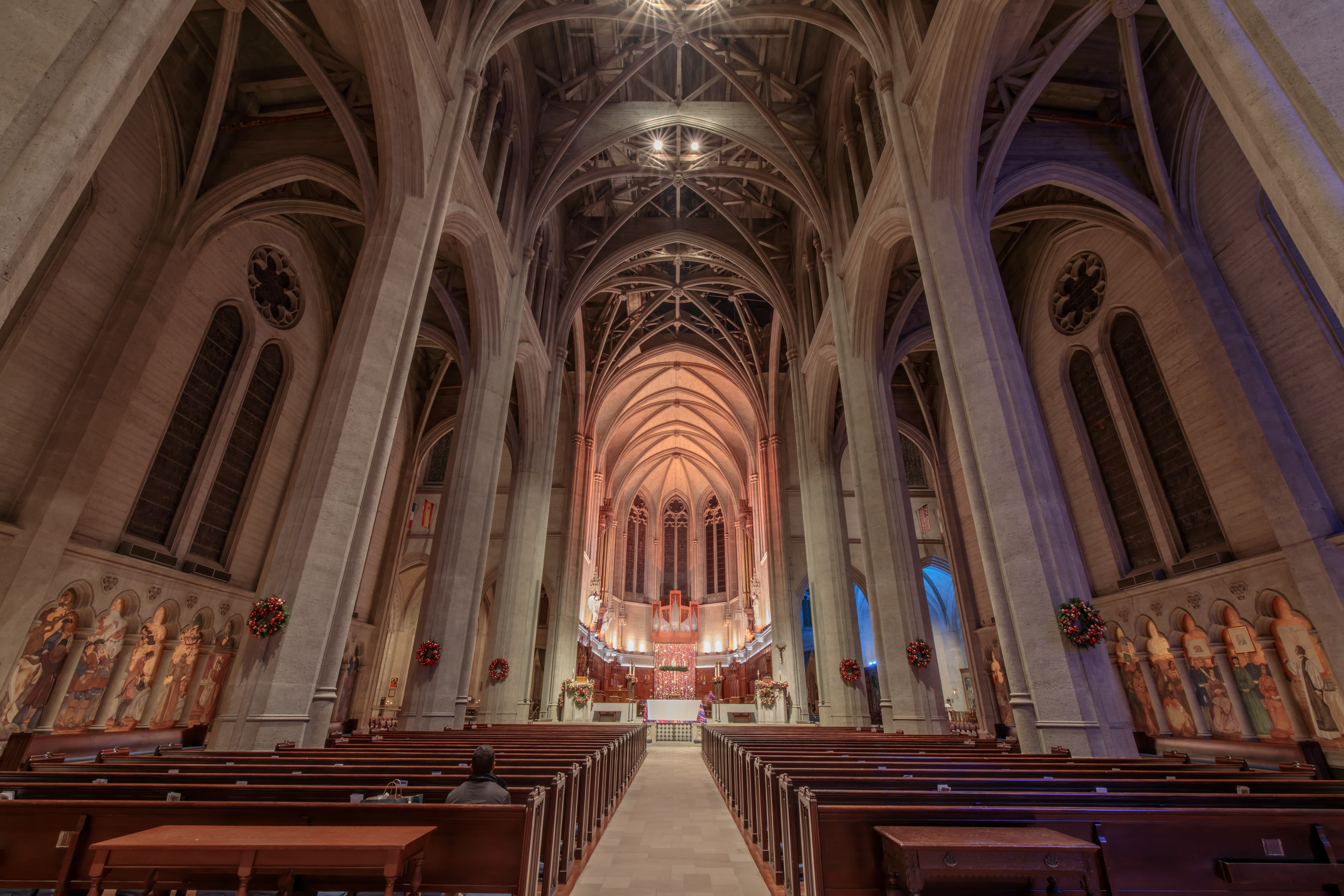 The interior of Grace Cathedral, a shot of the pews, which are empty, and views of the altar. Beautiful.