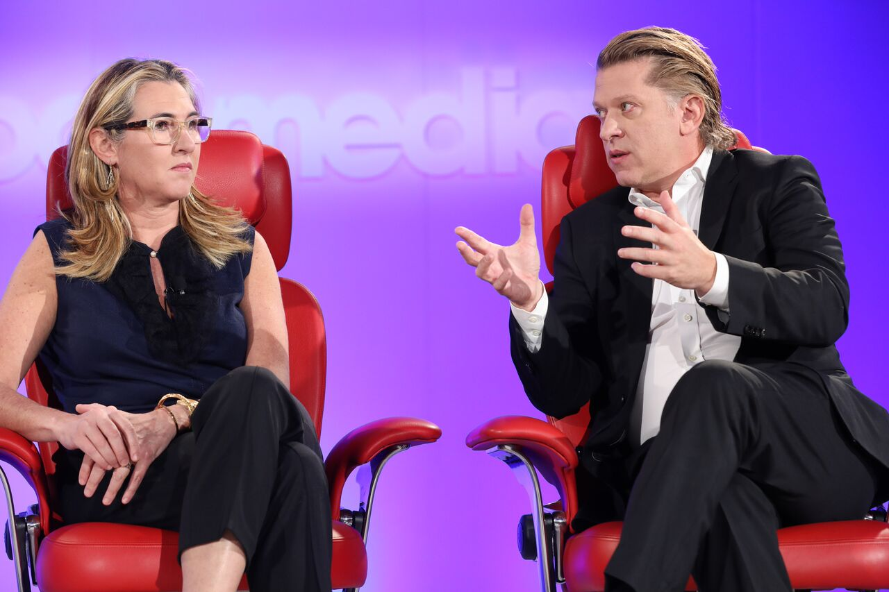 A&E CEO Nancy Dubuc and Turner CEO John Martin