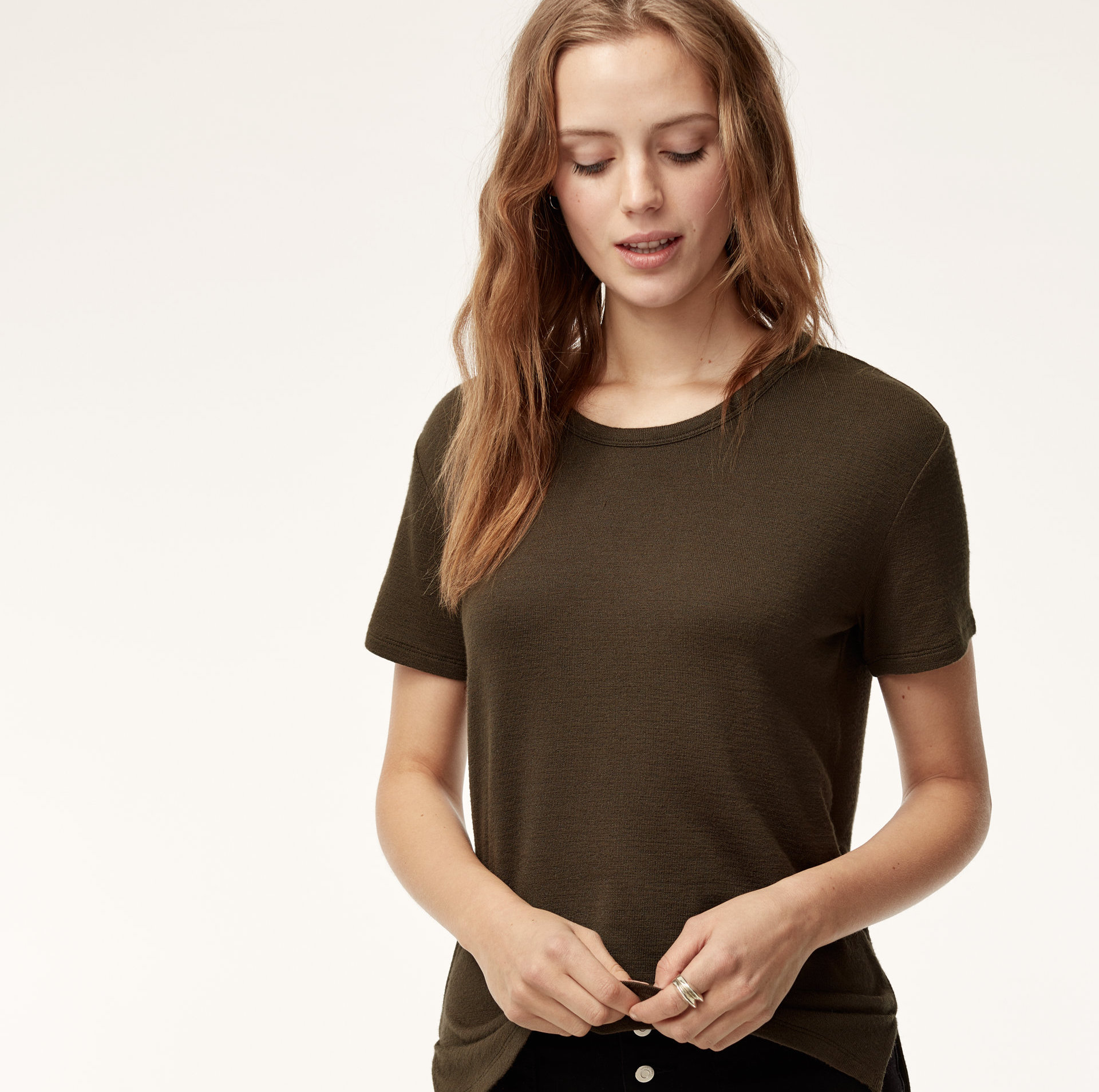 A model in a brown T-shirt