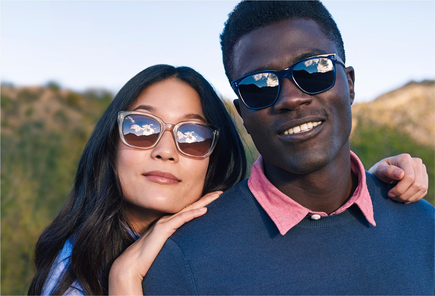 Two models wearing sunglasses