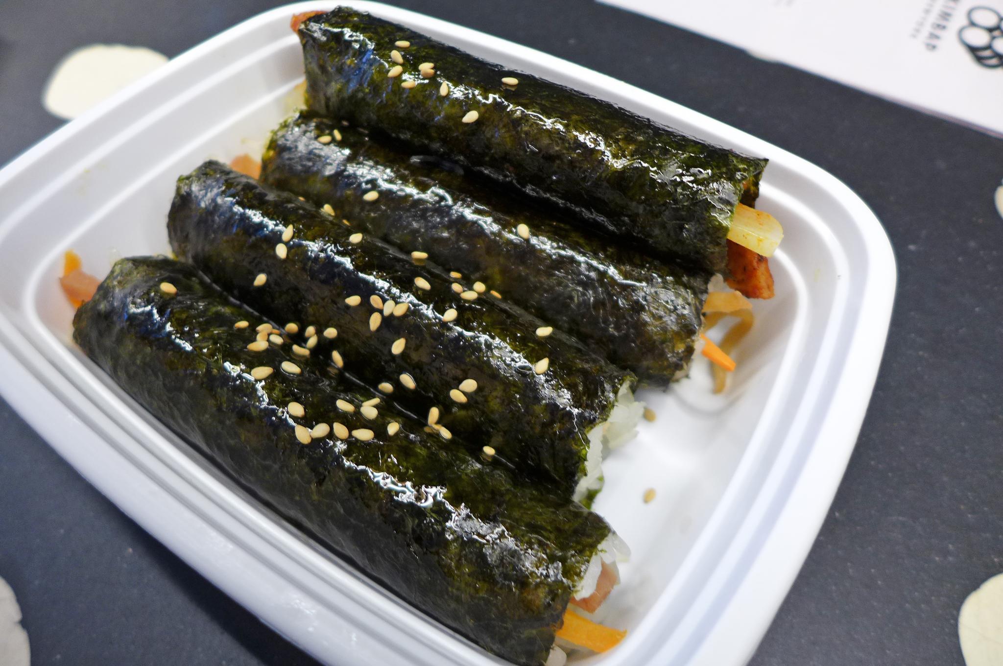 Sprinkled with sesame seeds, four mini kimbap make a nice light meal.
