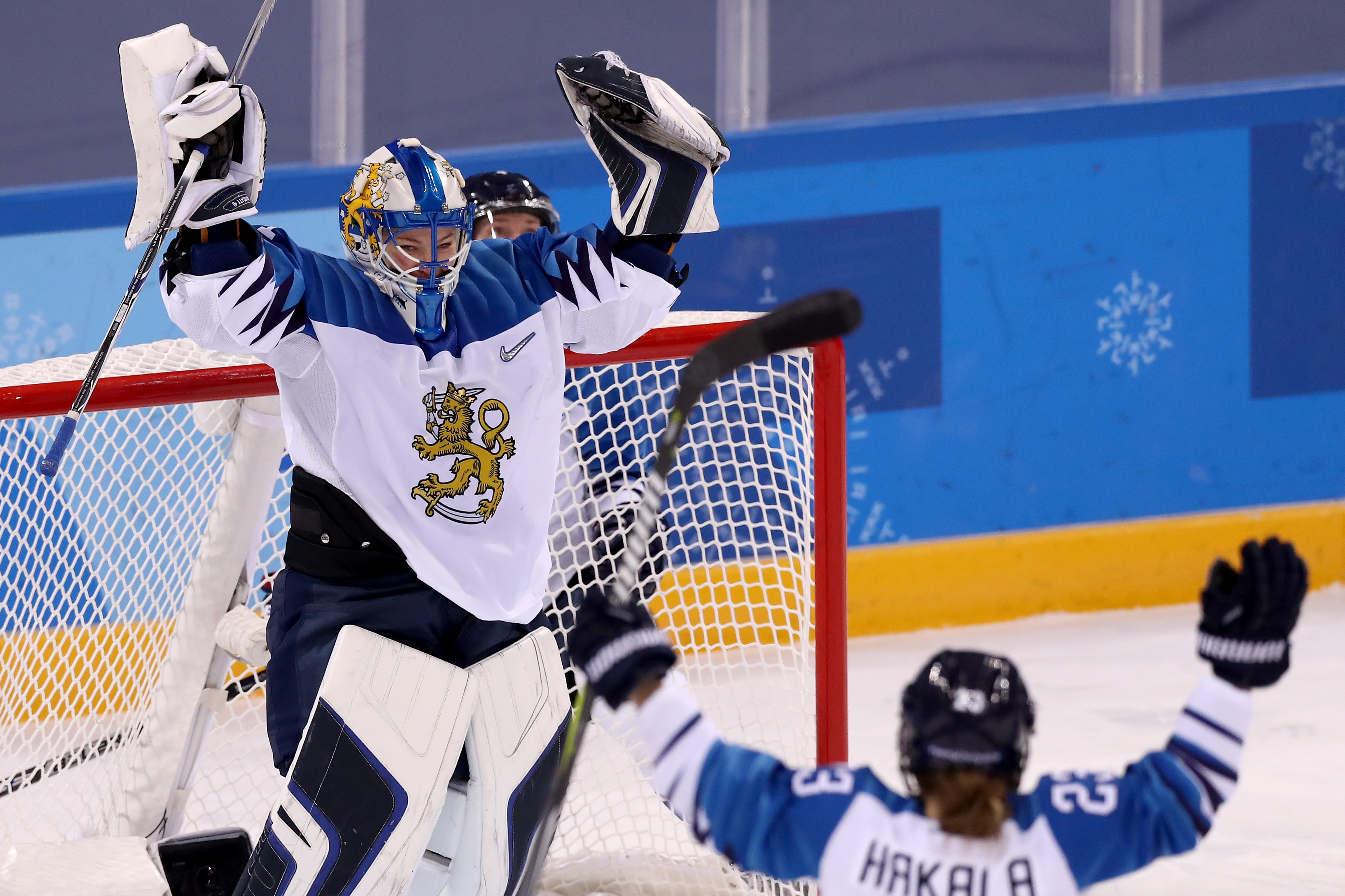 Noora Raty #41 of Finland celebrates with her teammates after defeating Team Sweden during the Ice Hockey Women's Play-offs Quarterfinals