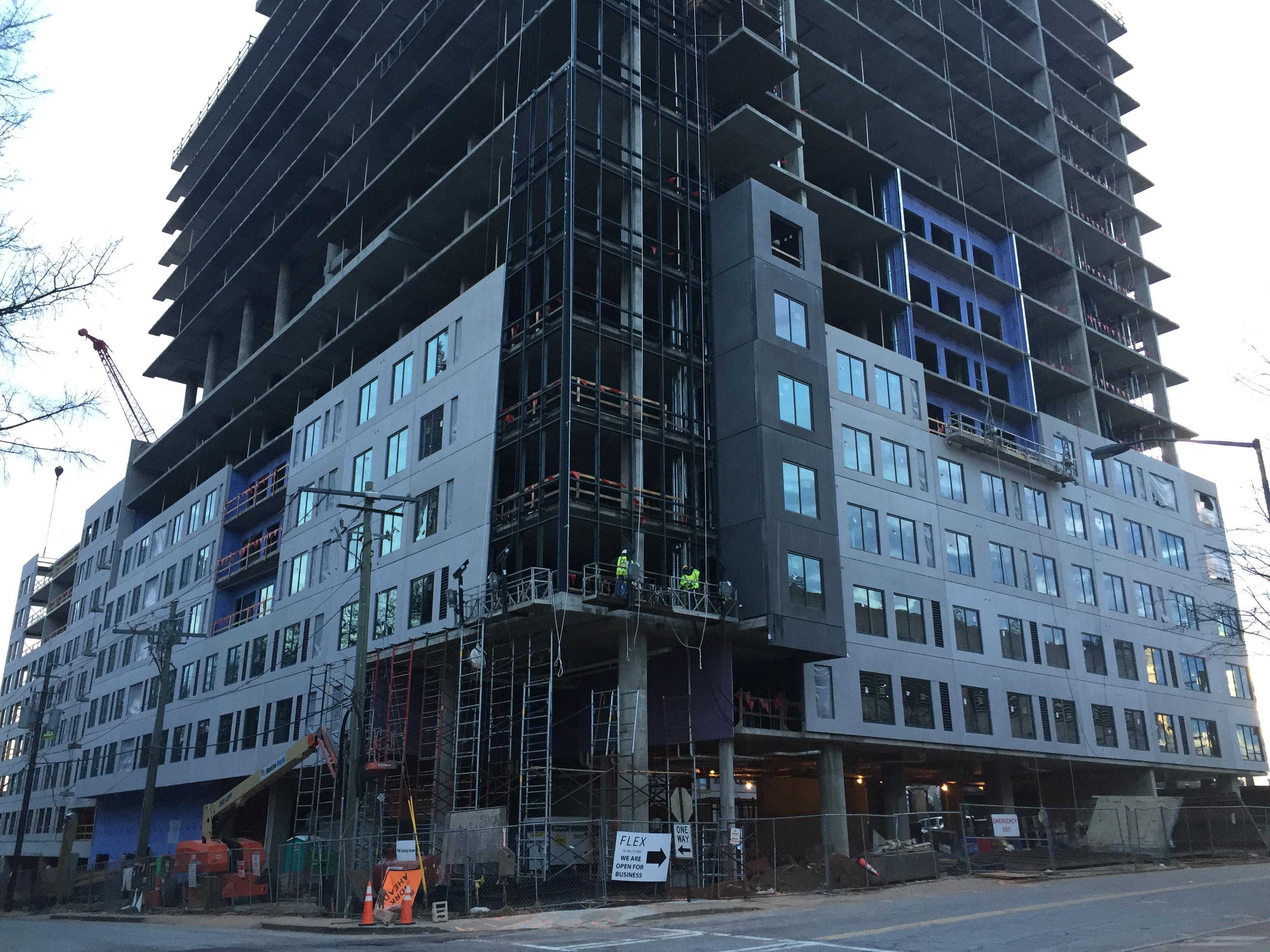 Precast concrete facade panels to seven stories on a concrete building.