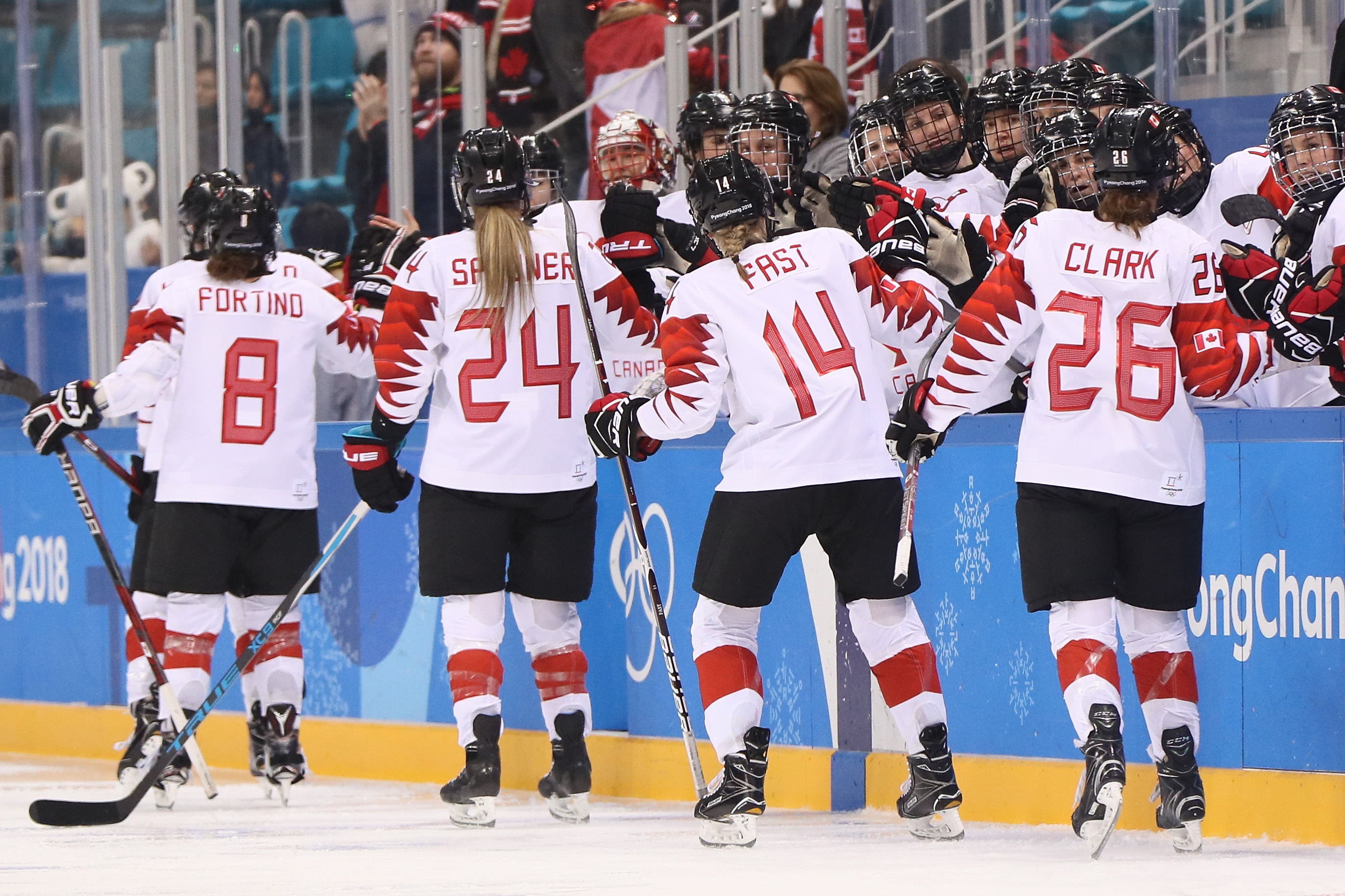 Team Canada celebrates after a goal against Olympic Athletes from Russia during the Ice Hockey Women Play-offs Semifinals