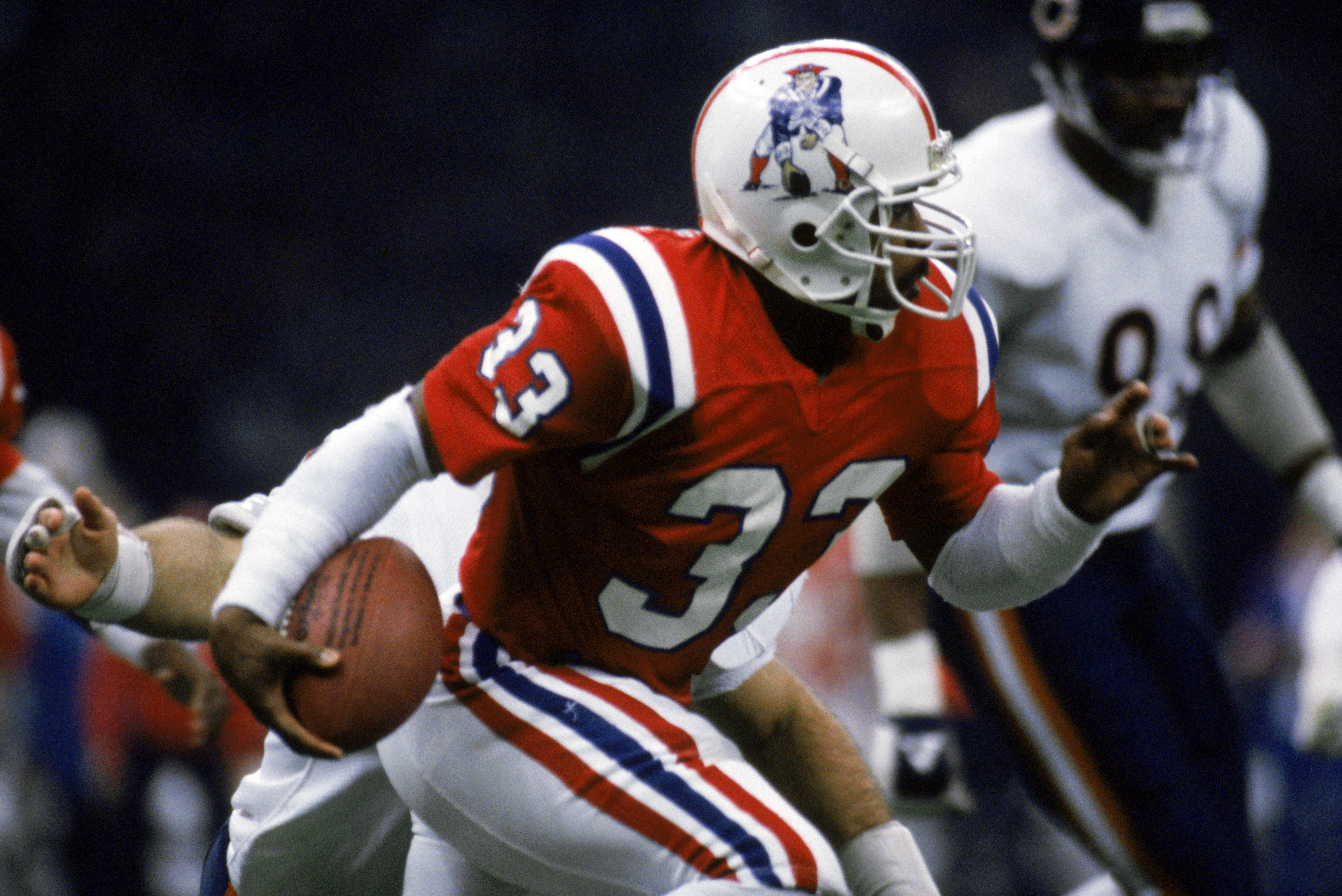 Tony Collins carries the ball