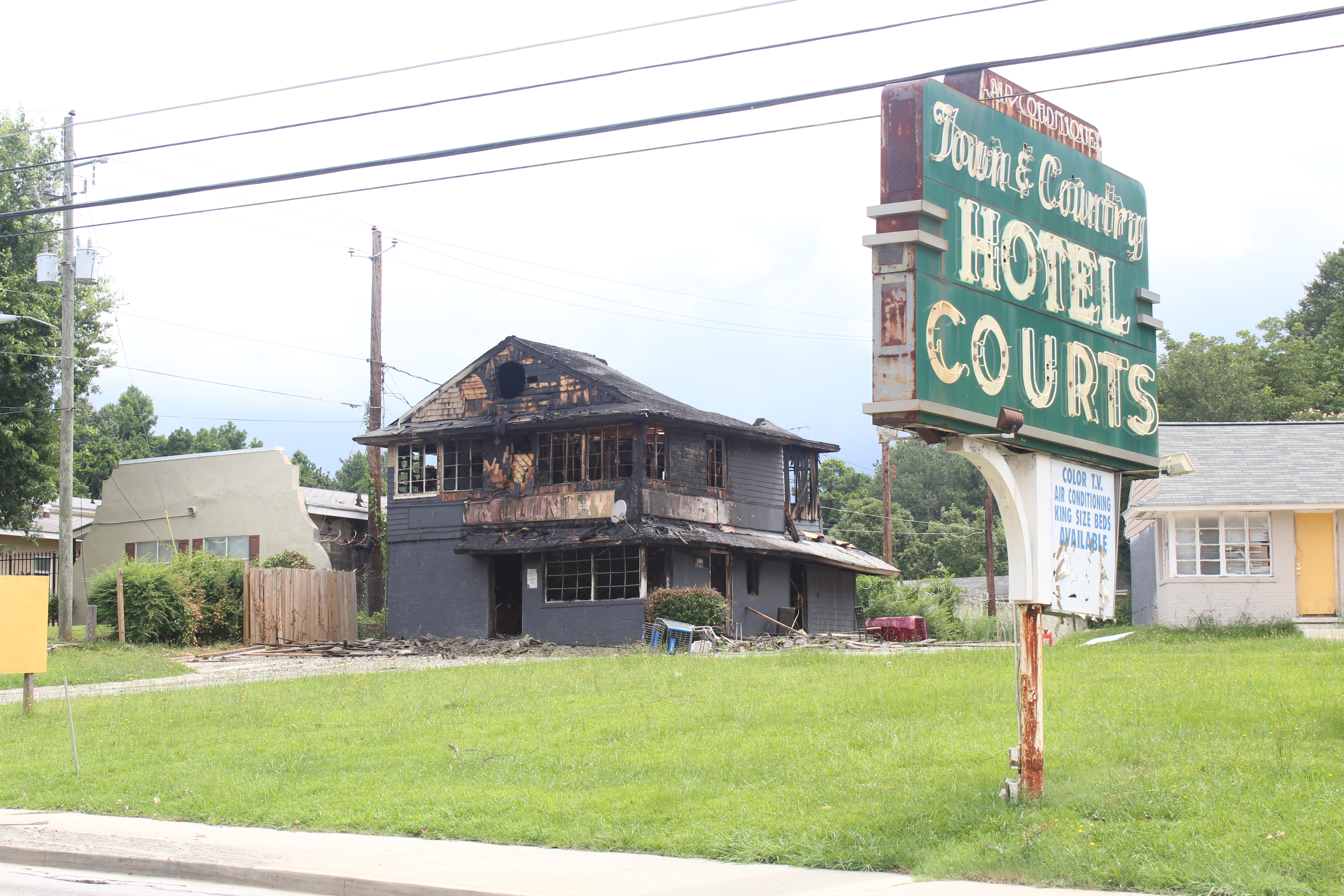 Five miles south of downtown in Perkerson Park, the Town and Country Hotel Courts is a former haven for squatters. Four buildings on the 2.3-acre property are all uninhabitable.