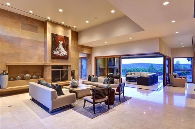 Large contemporary living area with wall-sized window door