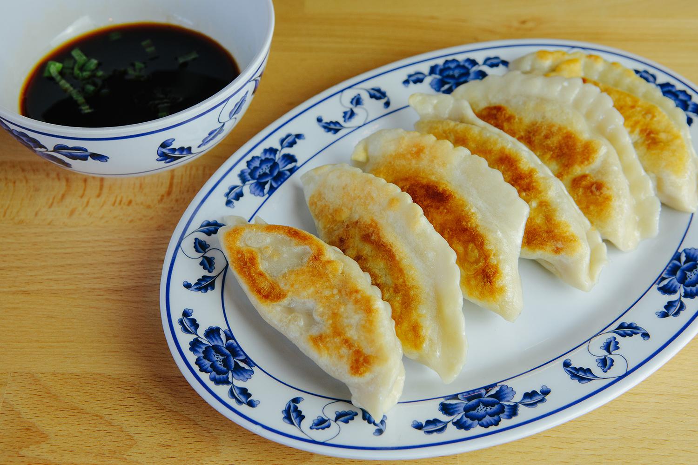 Pan-seared pork and cabbage dumplings at Dumpling Daughter in Weston