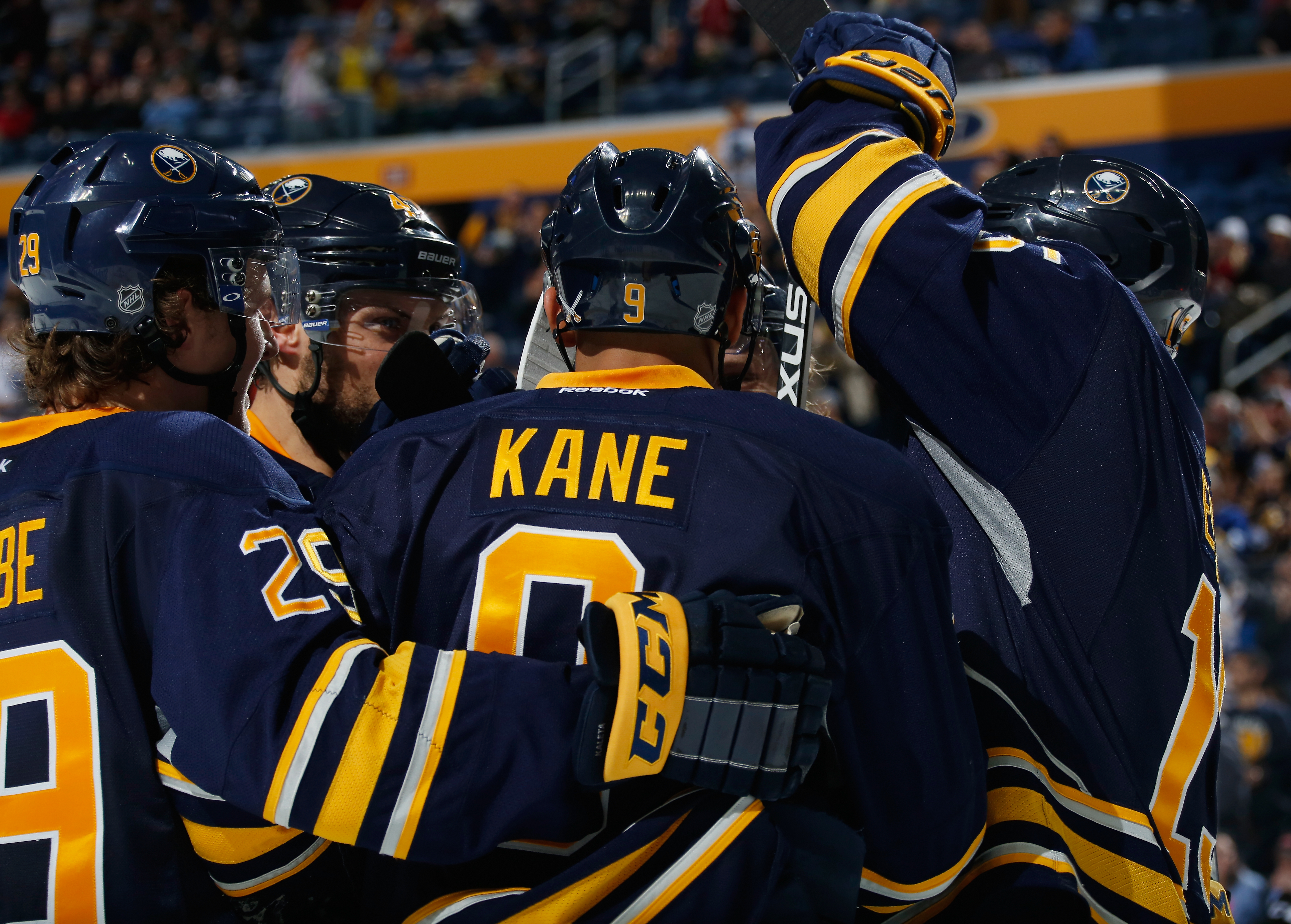 BUFFALO, NY - DECEMBER 17: Evander Kane #9 of the Buffalo Sabres celebrates his goal against the Anaheim Ducks with teammates at First Niagara Center on December 17, 2015 in Buffalo, New York. Buffalo defeated Anaheim 3-0.