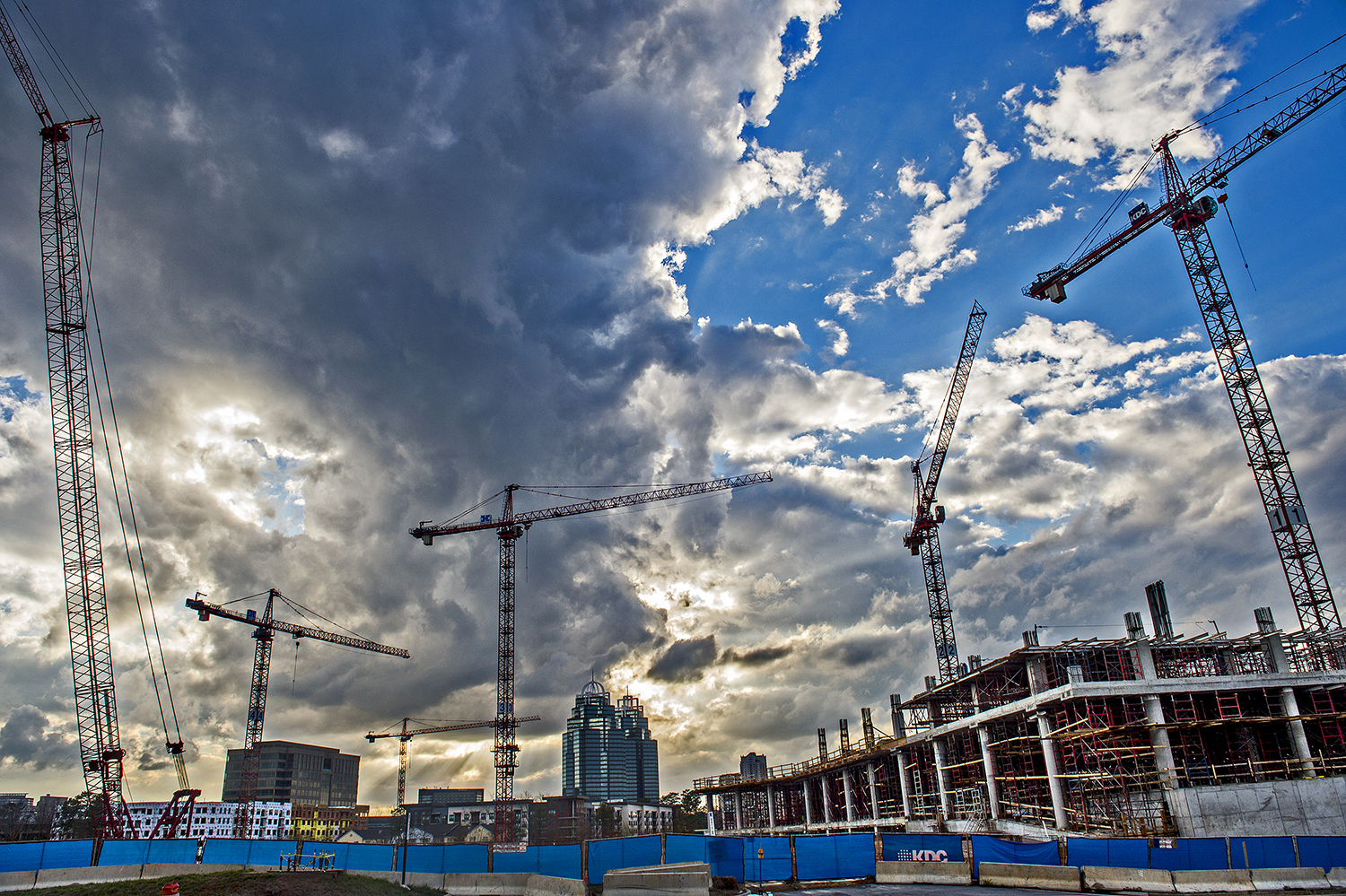 A photo of how cranes dot the skyline over phase two of Park Center in Dunwoody.