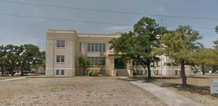 Three-story limestone schoolhouse