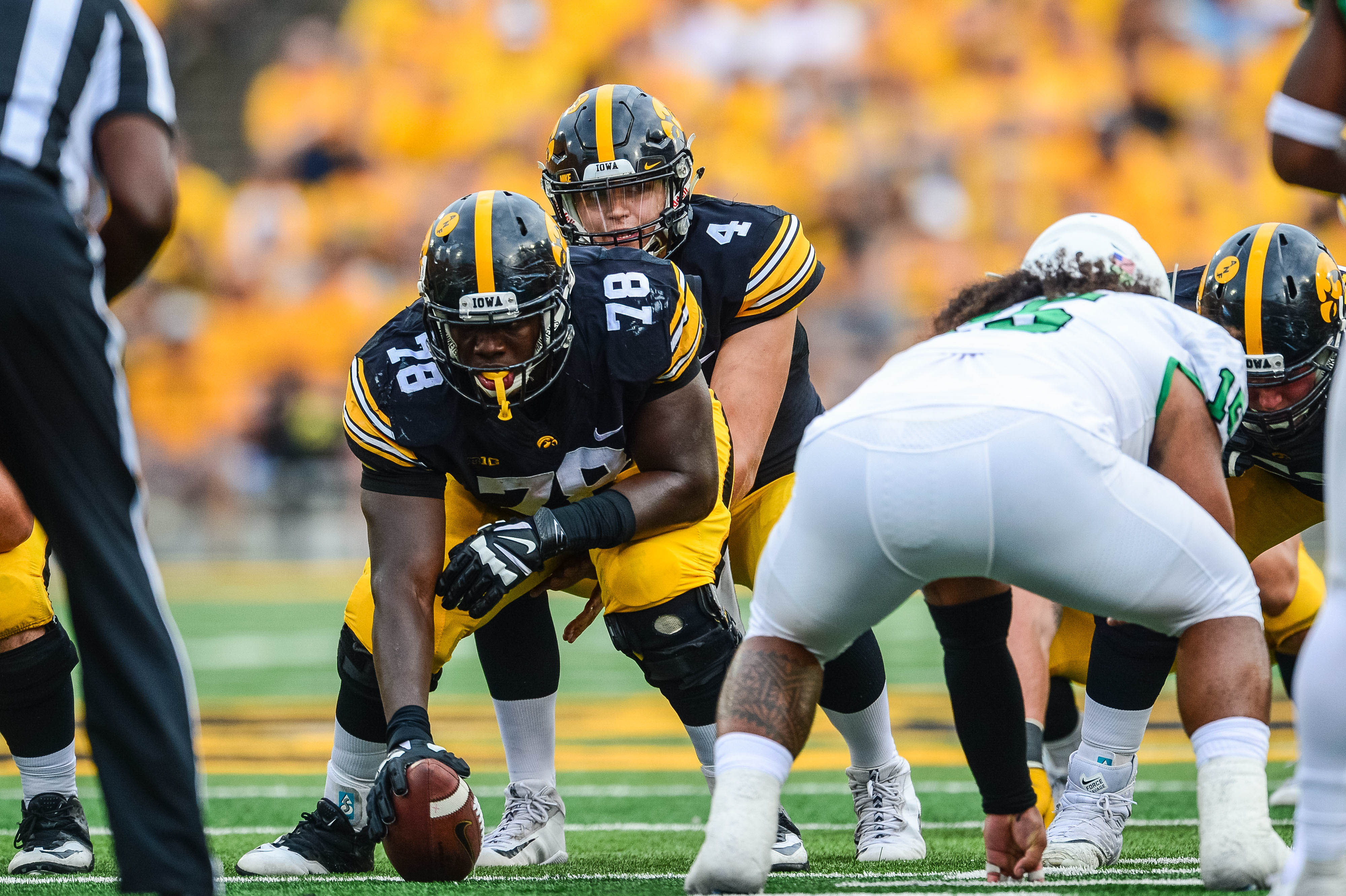 Iowa C James Daniels prepares to snap the ball to QB Nathan Stanley