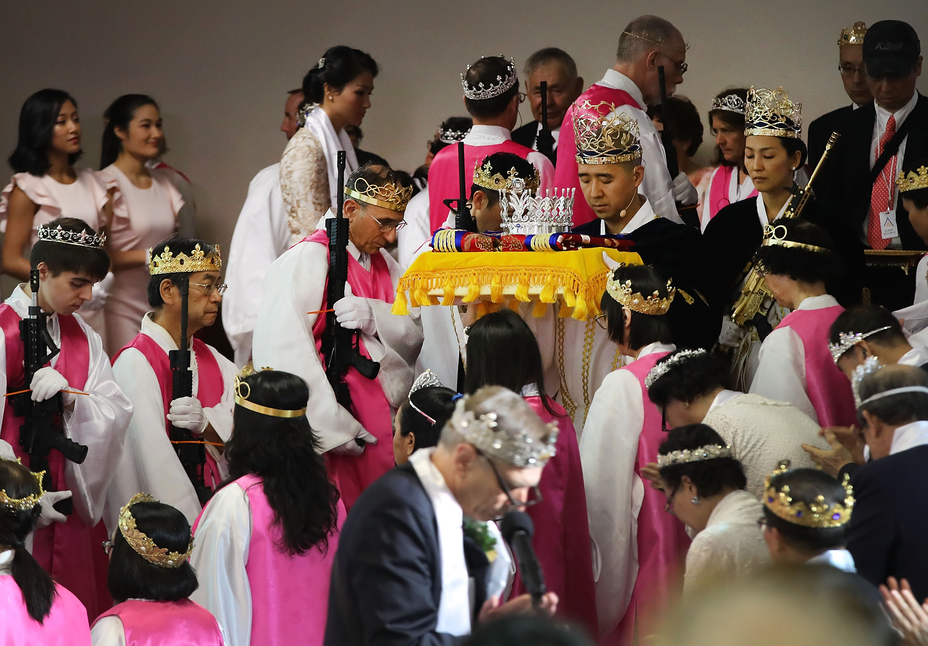 The cultlike church behind a ceremony with AR-15s and bullet crowns