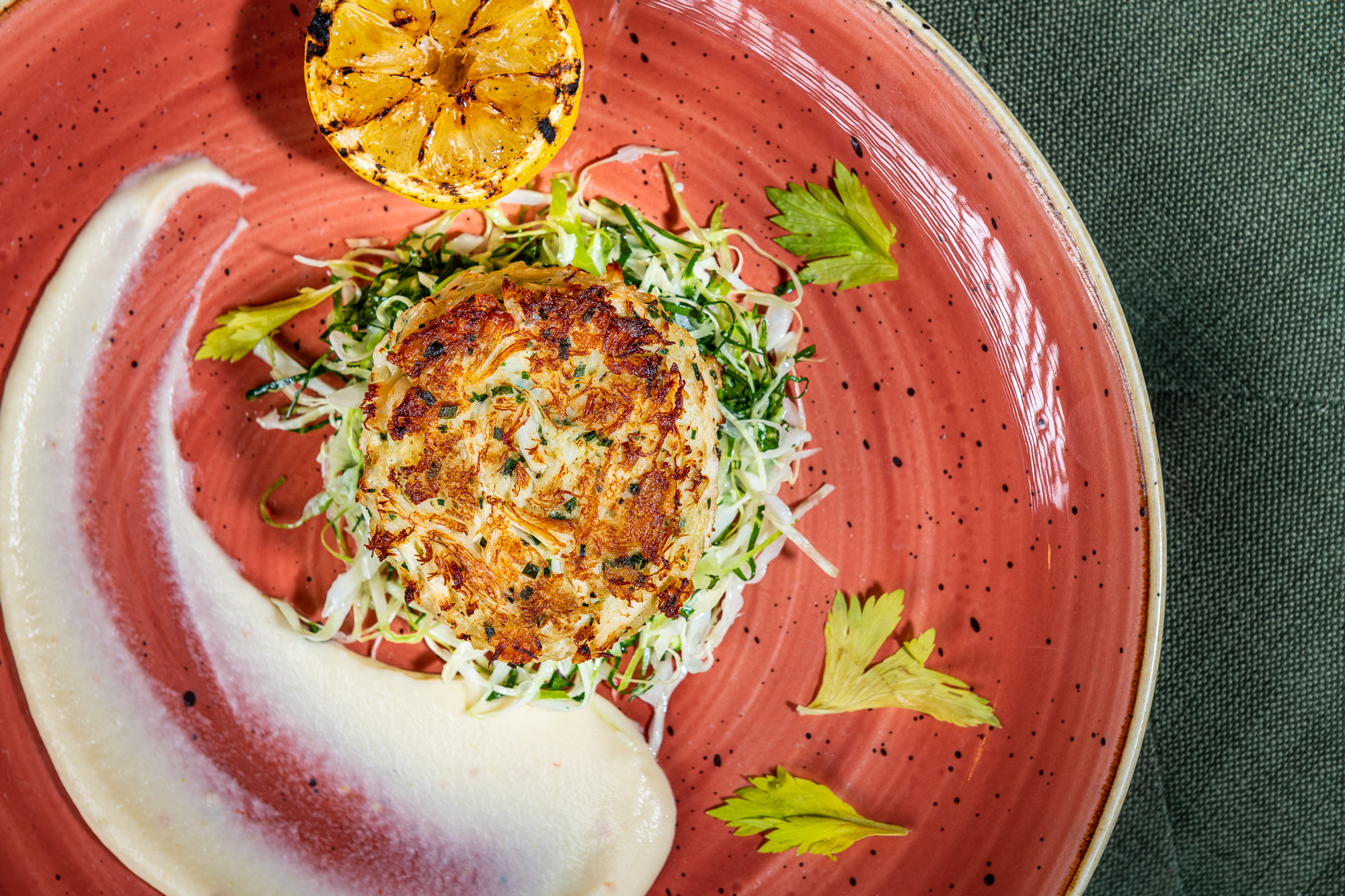 A crab cake with apple and butter puree from Glover Park Grill
