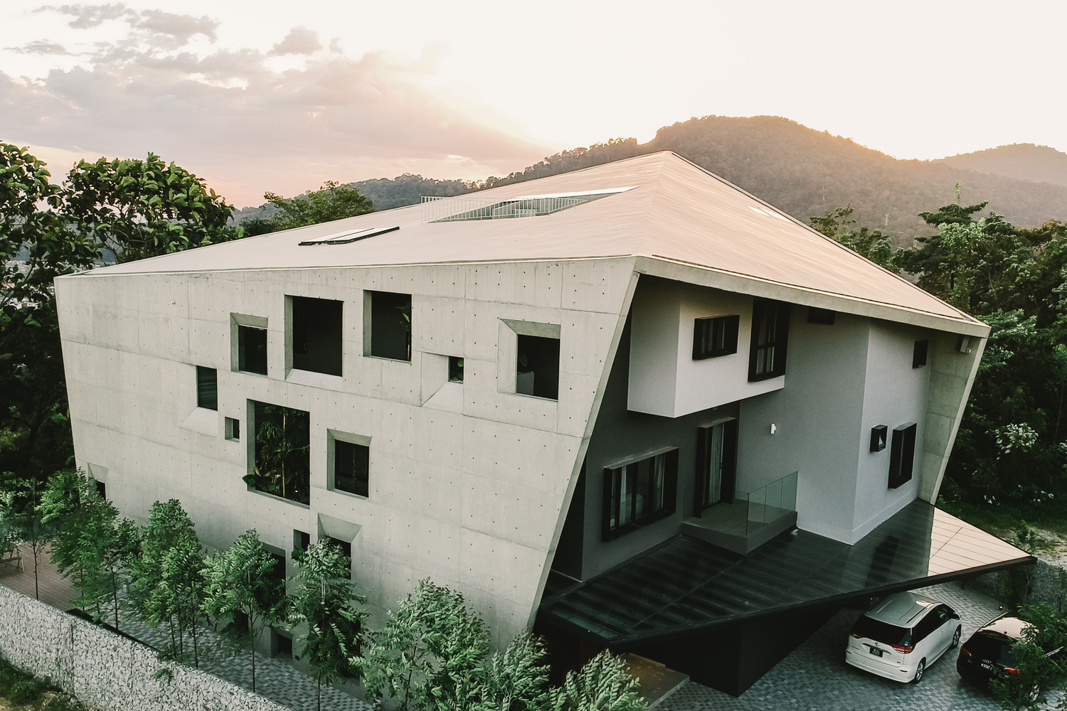 Modern home covered in a concrete shell of windows