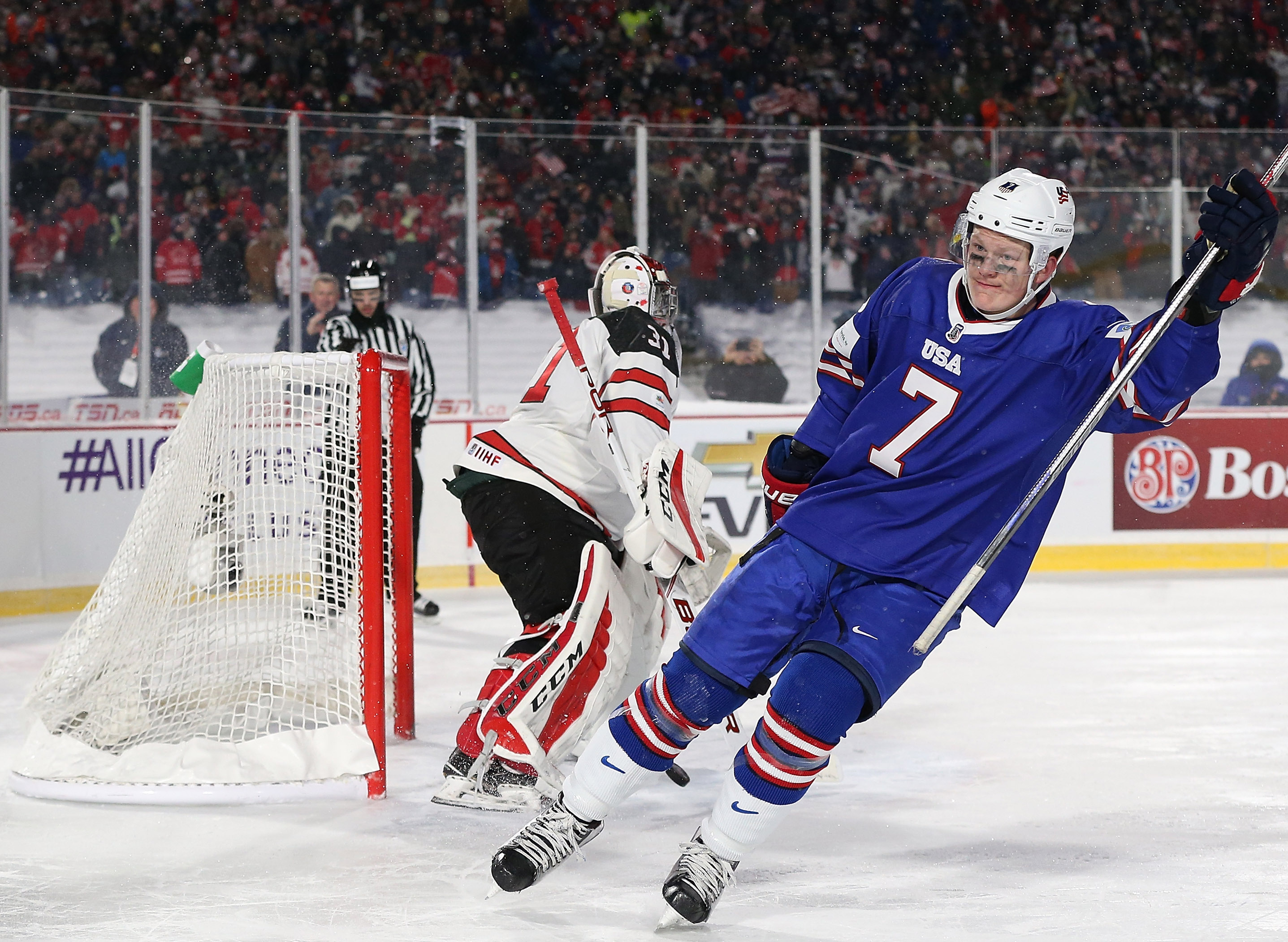 Brady Tkachuk #7 of United States scores a goal against Carter Hart #31 of Canada in the shootout against Canada during the IIHF World Junior Championship at New Era Field on December 29, 2017 in Buffalo, New York. The United States beat Canada 4-3.