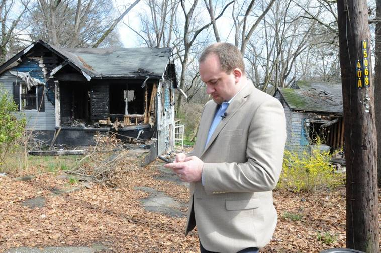 District 9 Councilmember Dustin Hillis is pictured using an app called SeeClickFix to submit code enforcement issues to the city.
