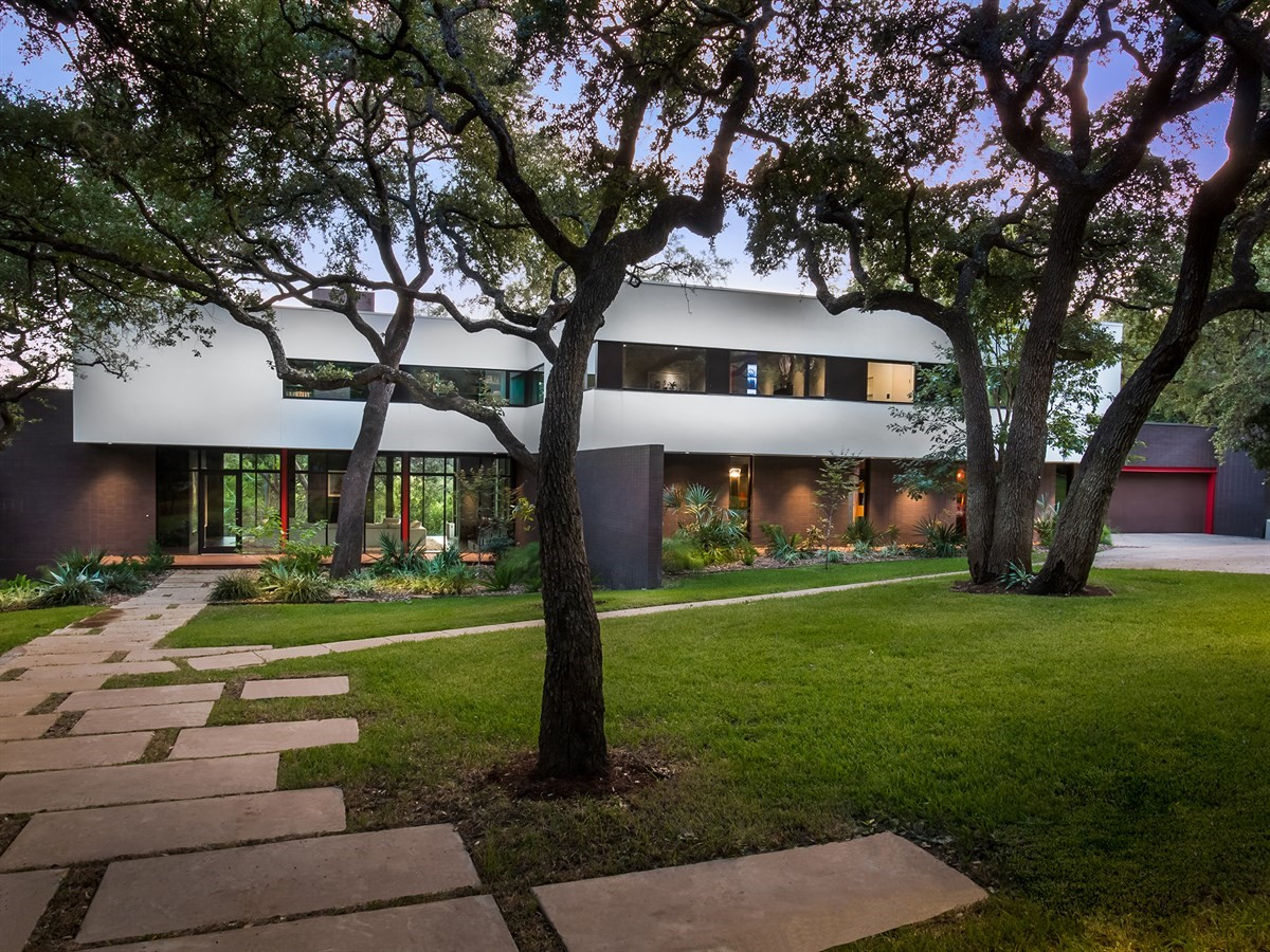 Two-story contemporary with Live Oaks