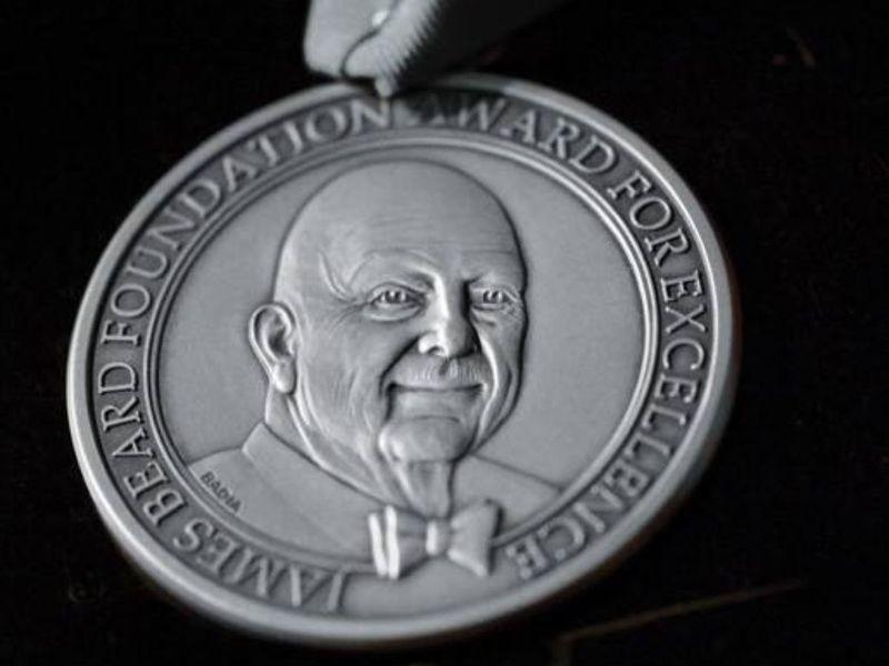 A James Beard Award medal.