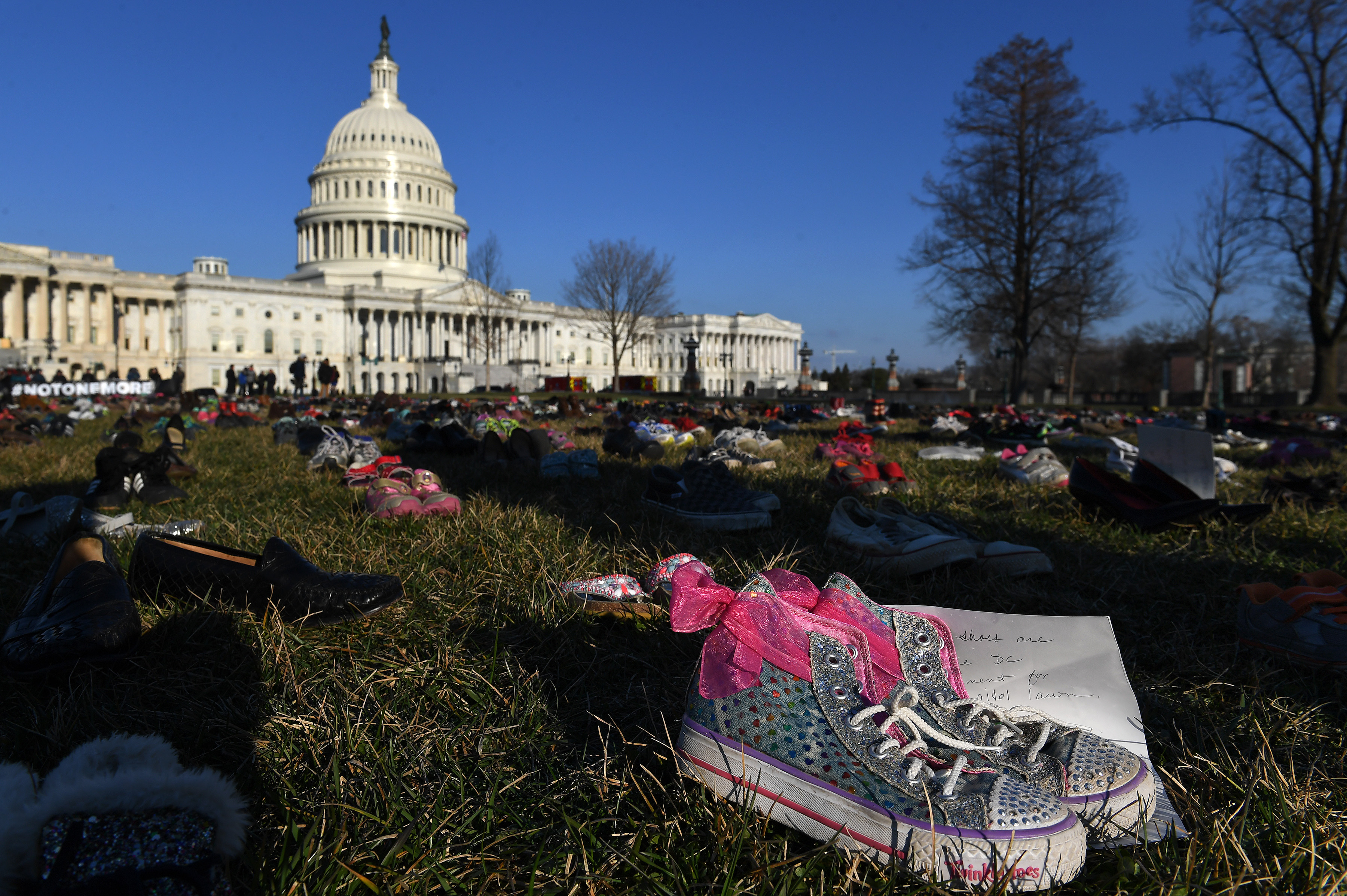 To commemorate child victims of gun violence, 7,000 shoes were left at the US Capitol.