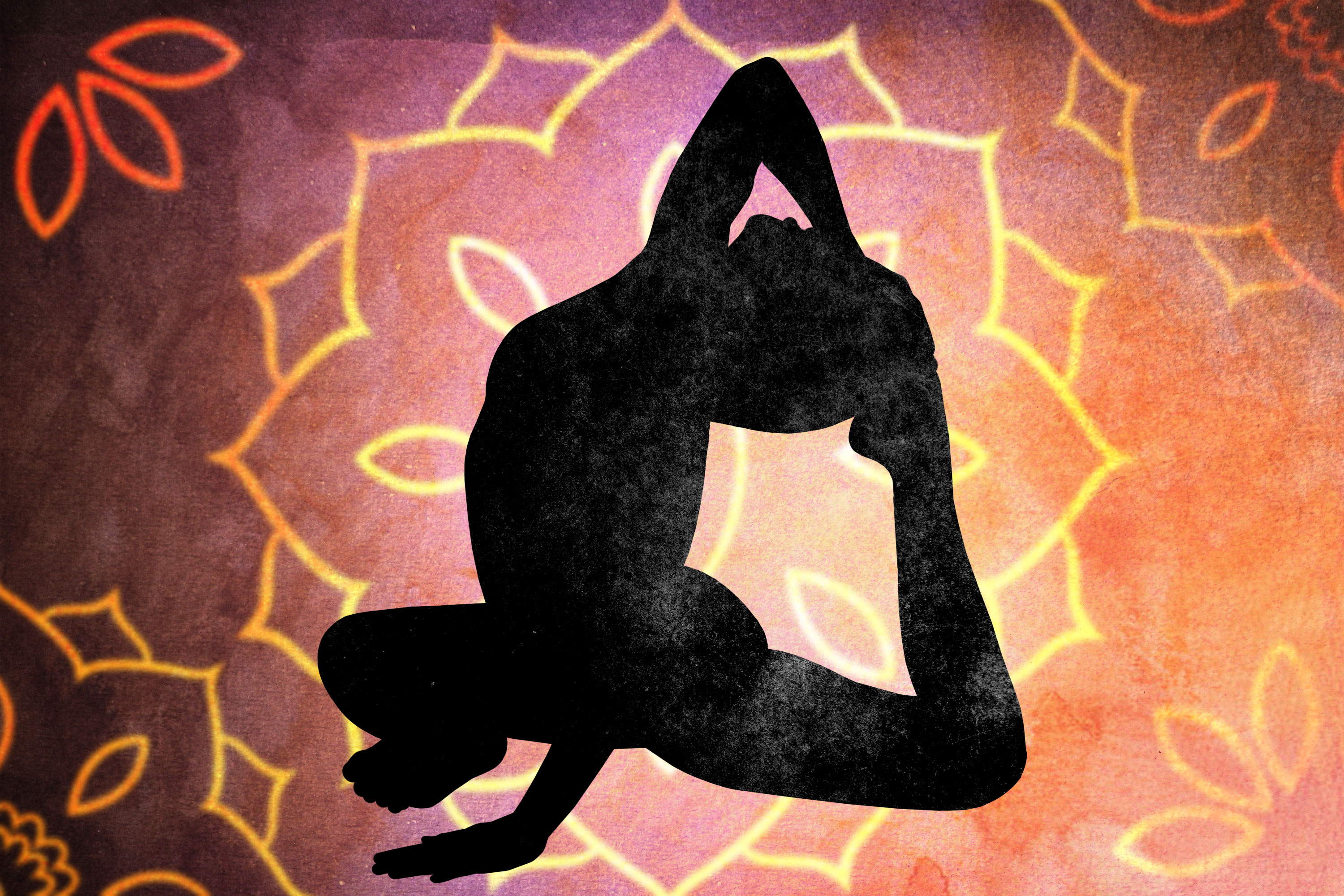 The silhouette of someone in a yoga pose