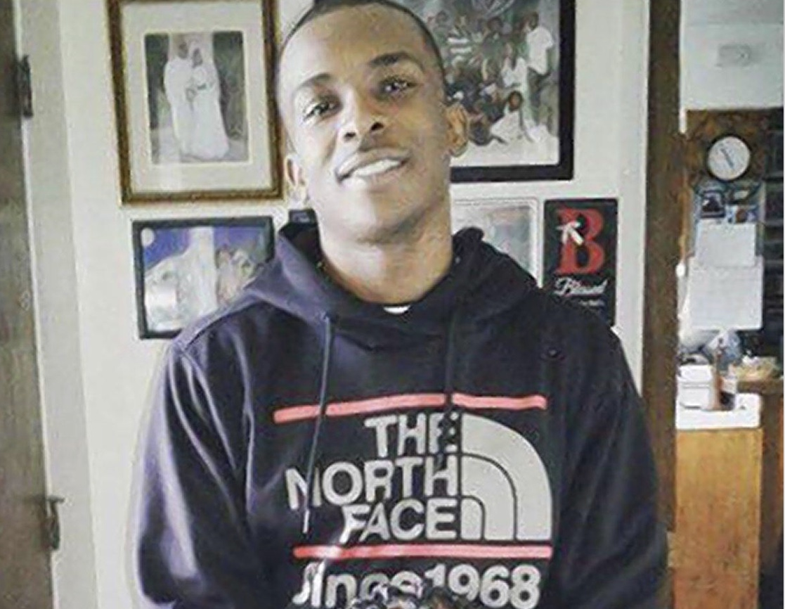 Police shot and killed an unarmed black man in his own backyard. All he was holding was a cellphone.