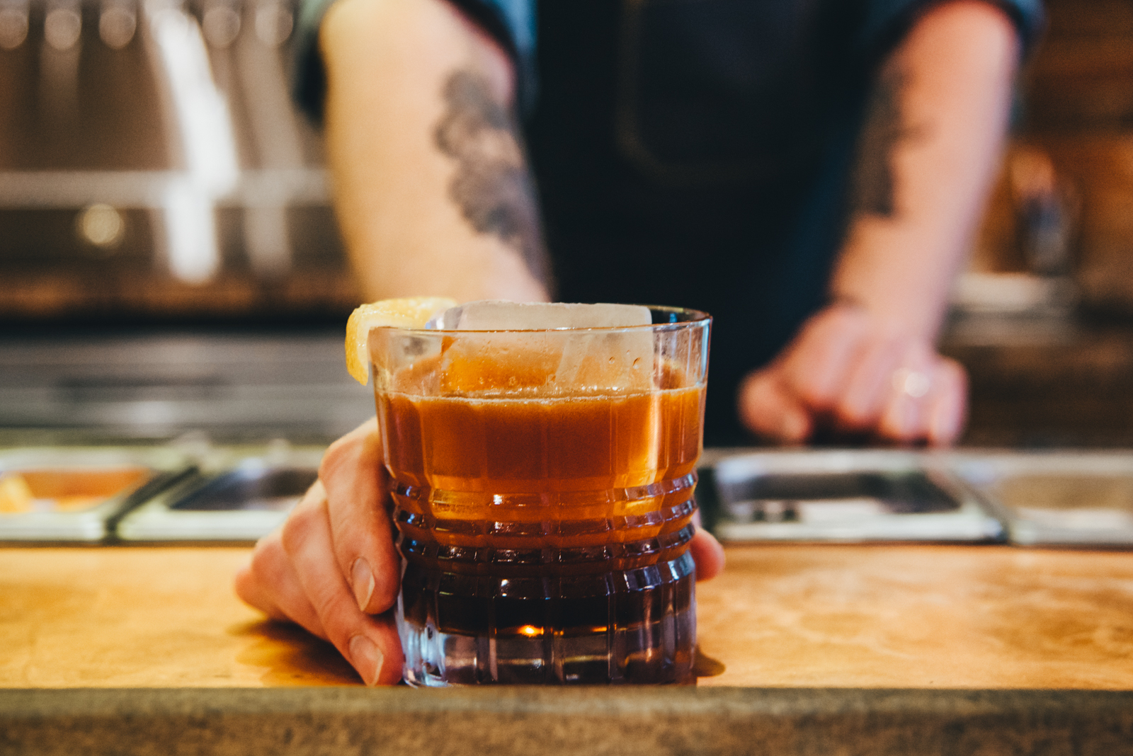 A nitrogen-infused peanut bourbon and cola at the playful new Brass Tacks