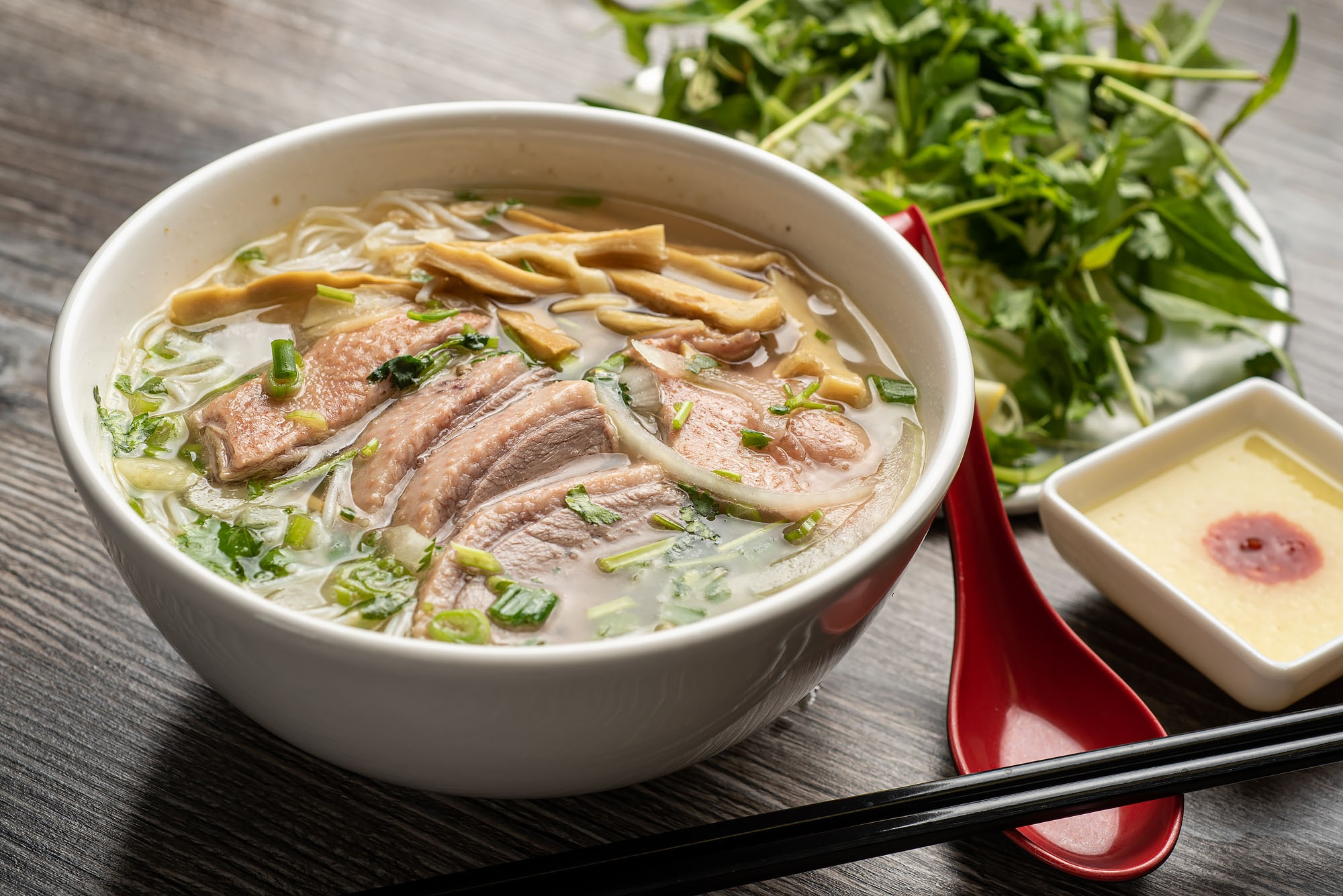 Bun mang vit, duck and bamboo noodle soup with herbs and sauce at Pho Ga