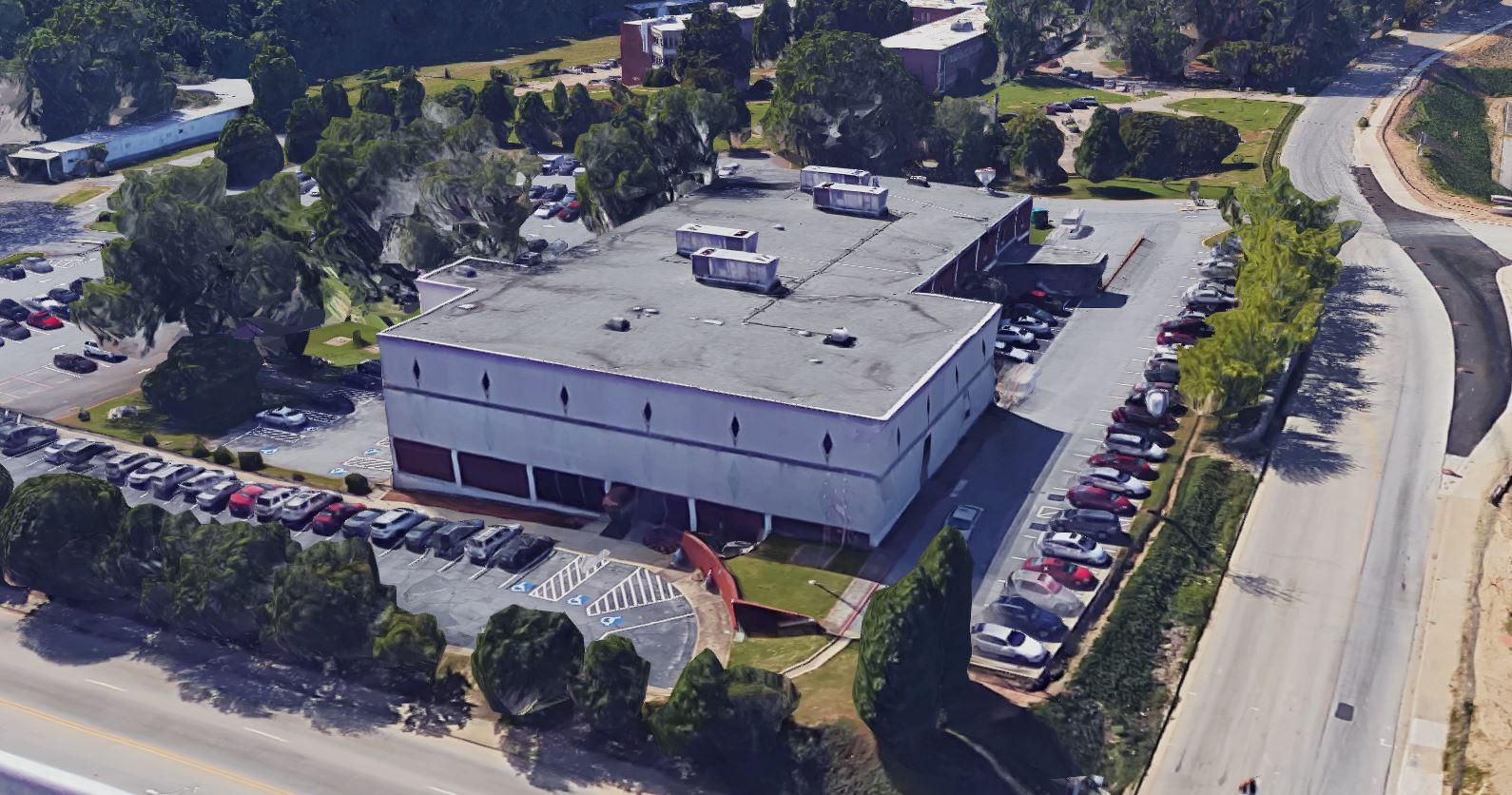 An aerial view of a nearly windowless three-story brick building.