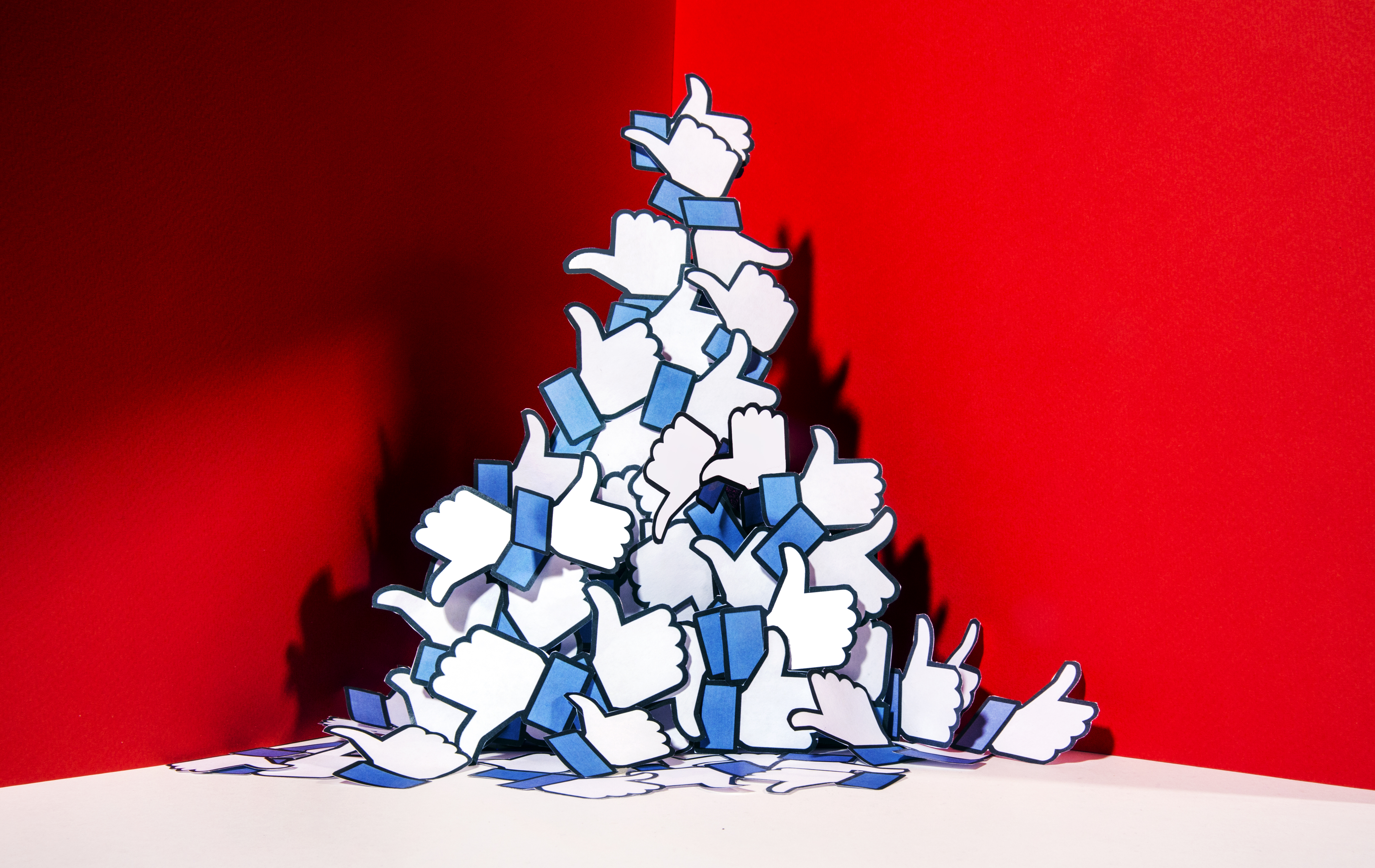 A drawing of a pile of the Facebook thumbs-up icons.