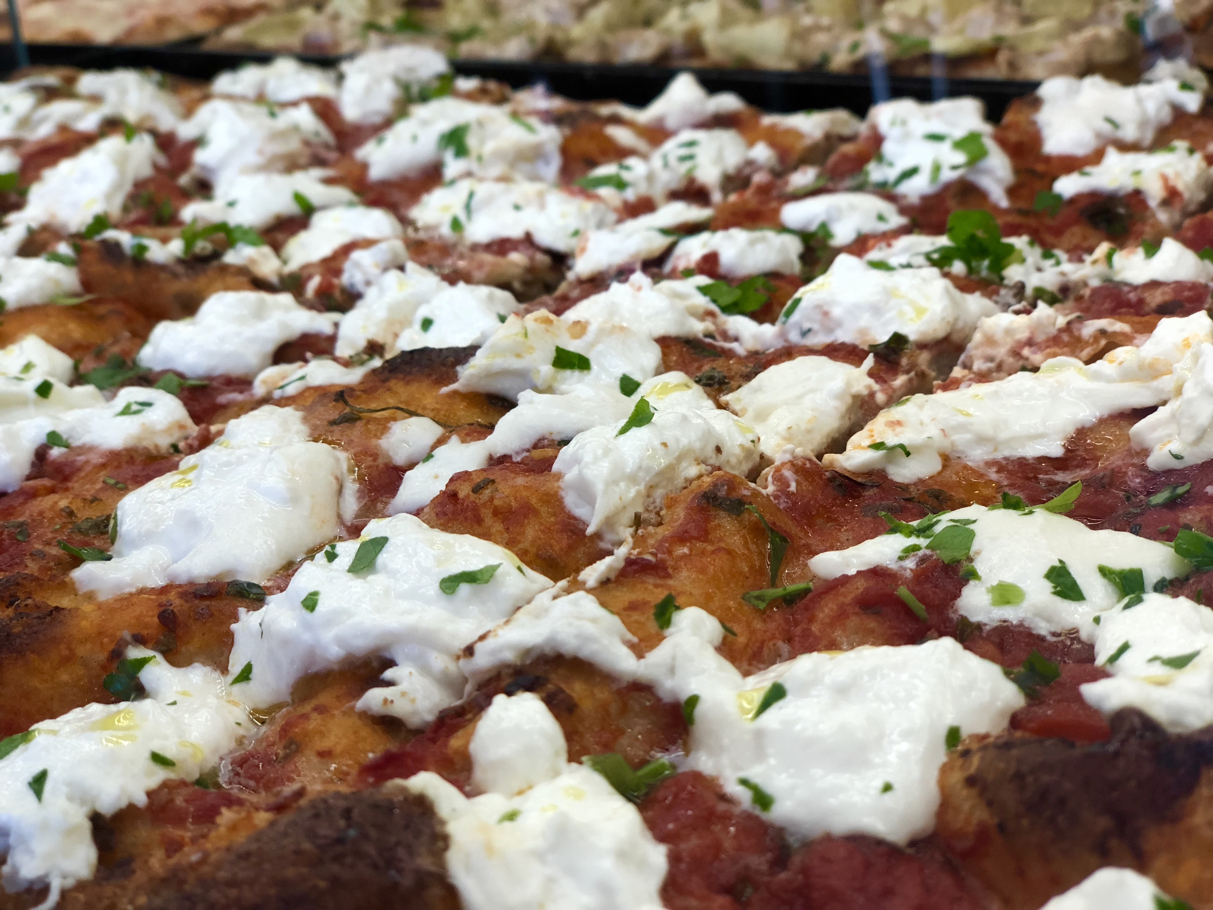 Slices and slices of burrata pizza from PQR