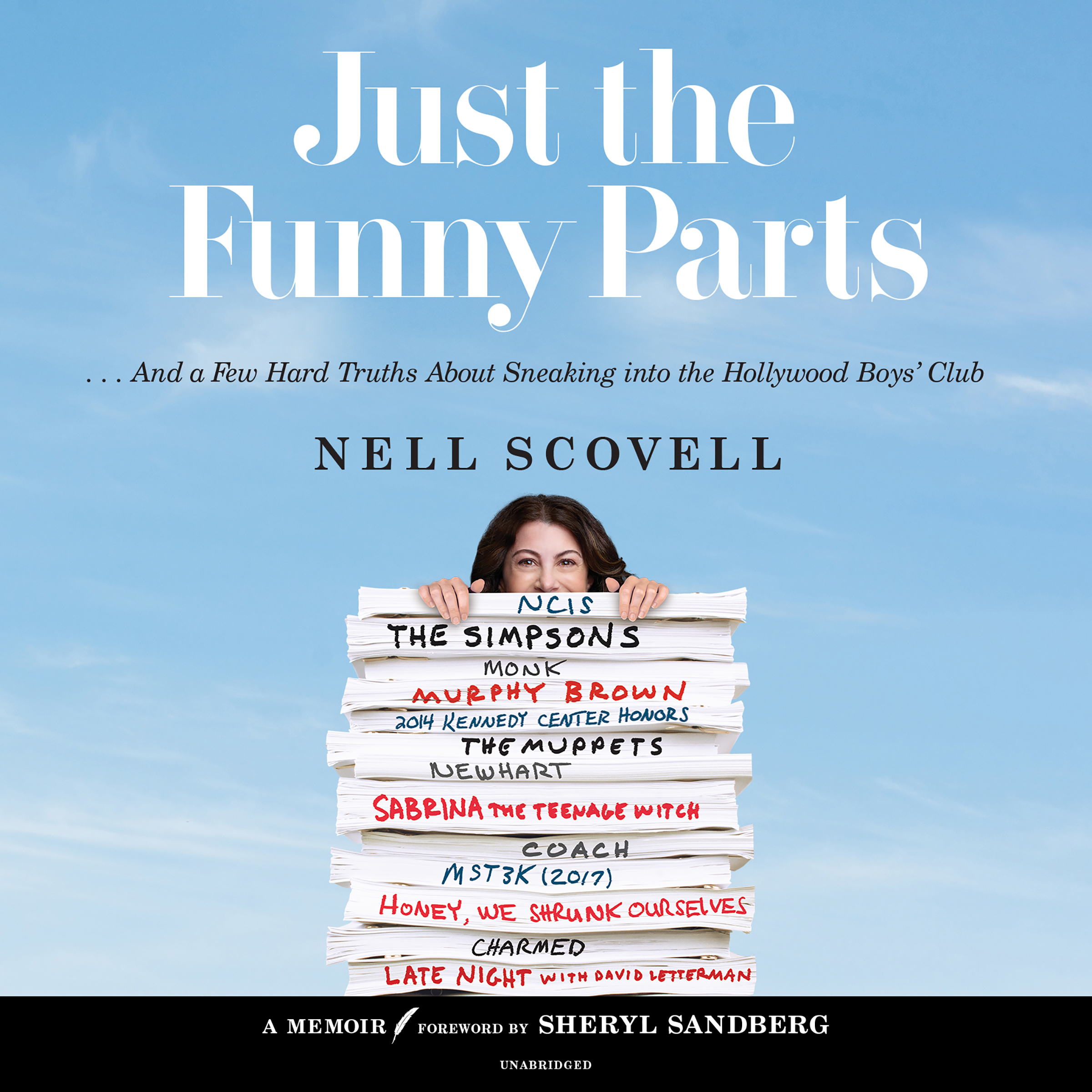 """On the cover of """"Just the Funny Parts,"""" author Nell Scovell peeks over a stack of scripts on which she has worked: NCIS, The Simpsons, Monk, Murphy Brown, 2014 Kennedy Center Honors, The Muppets, Newhart, Sabrina the Teenage Witch, Coach, and MST3K (2017)"""
